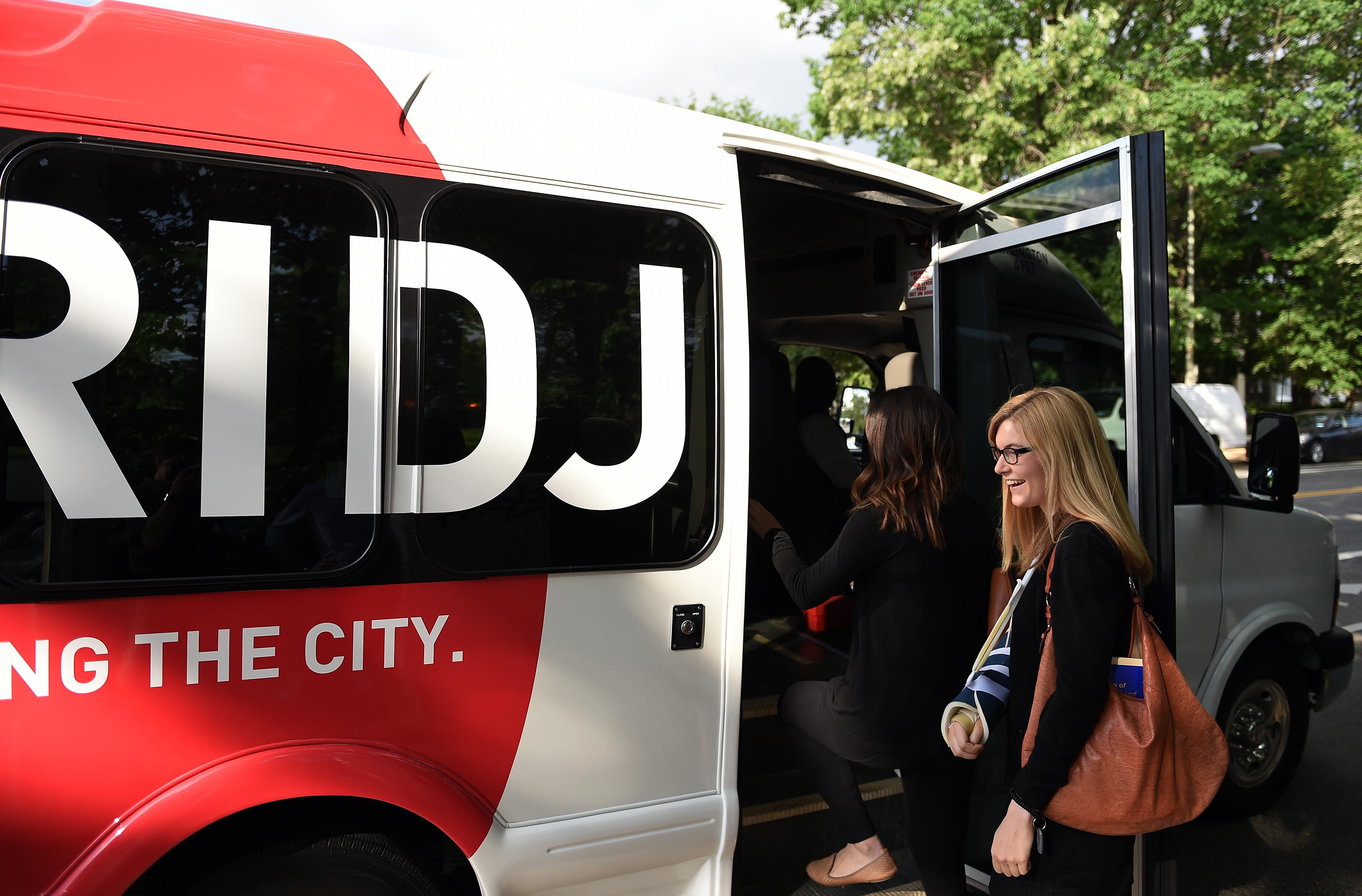 WASHINGTON, DC - May 13: Emily Bastina, 25, boards a Bridj bus