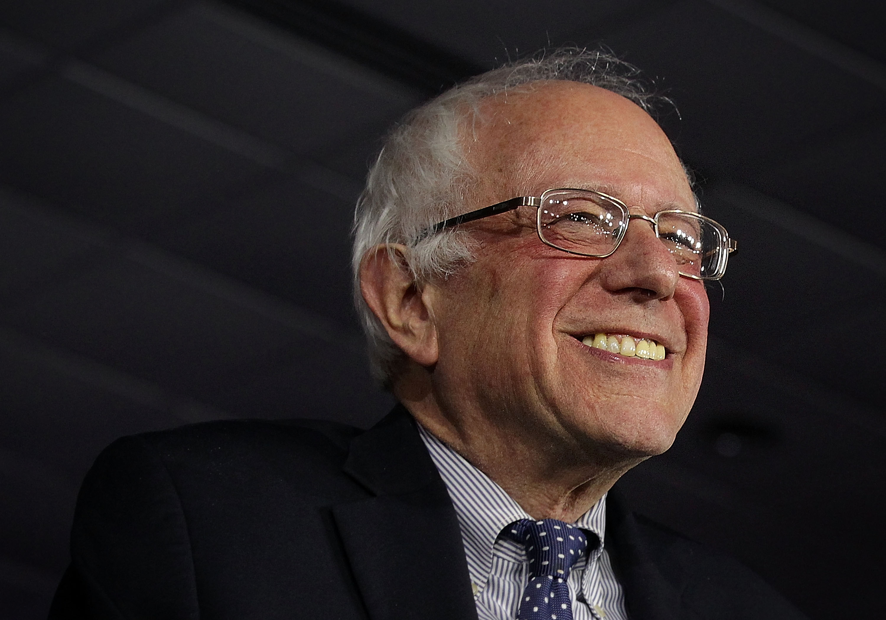 Democratic presidential candidate Sen. Bernie Sanders (I-VT) smiles as he speaks to supporters during a caucus night party in Des Moines, Iowa.