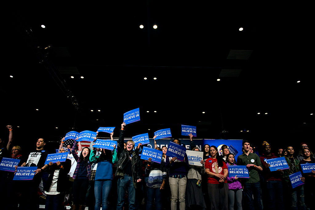 MINNEAPOLIS, MN- FEBRUARY 29: Supporters of Democratic presidential candidate Sen. Bernie Sanders (D-VT) wave signs during a campaign rally at the Minneapolis Convention CenterFebruary 29, 2016 in Minneapolis, Minnesota. Sanders, who has spent the last four days campaigning in Minnesota, is hoping to win the State in the Super Tuesday primary election on March 1st, 2016. (Photo by Stephen Maturen/Getty Images)