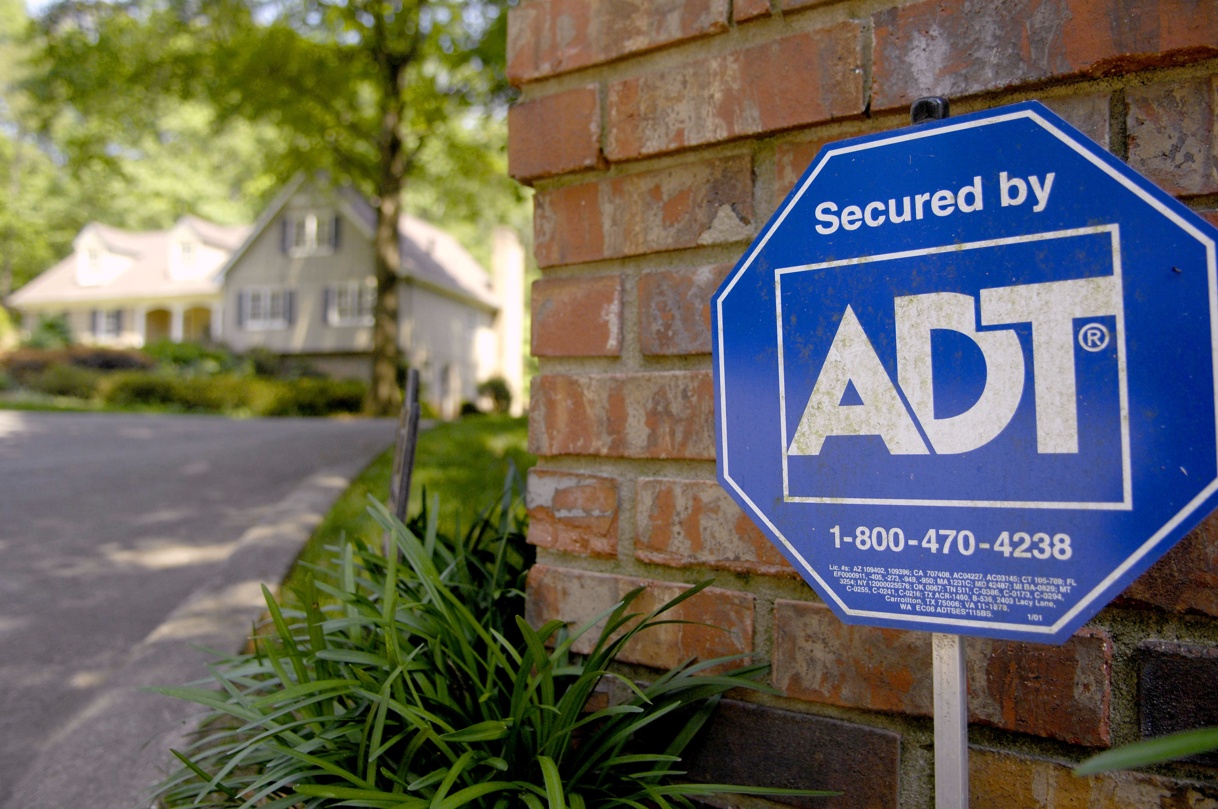 An ADT Security sign sits out in front of a home in Sandy Sp