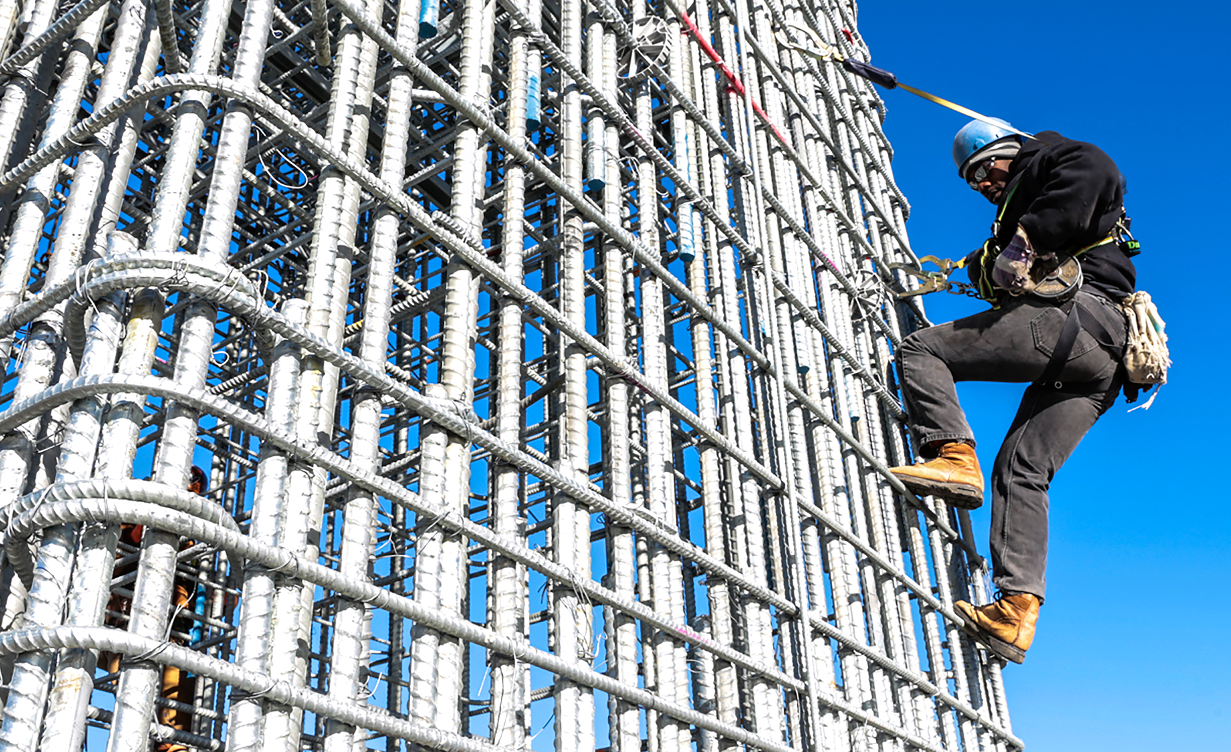 An ironworker scales a rebar cage while working on the Tappan Zee Bridge in Tarrytown, N.Y.