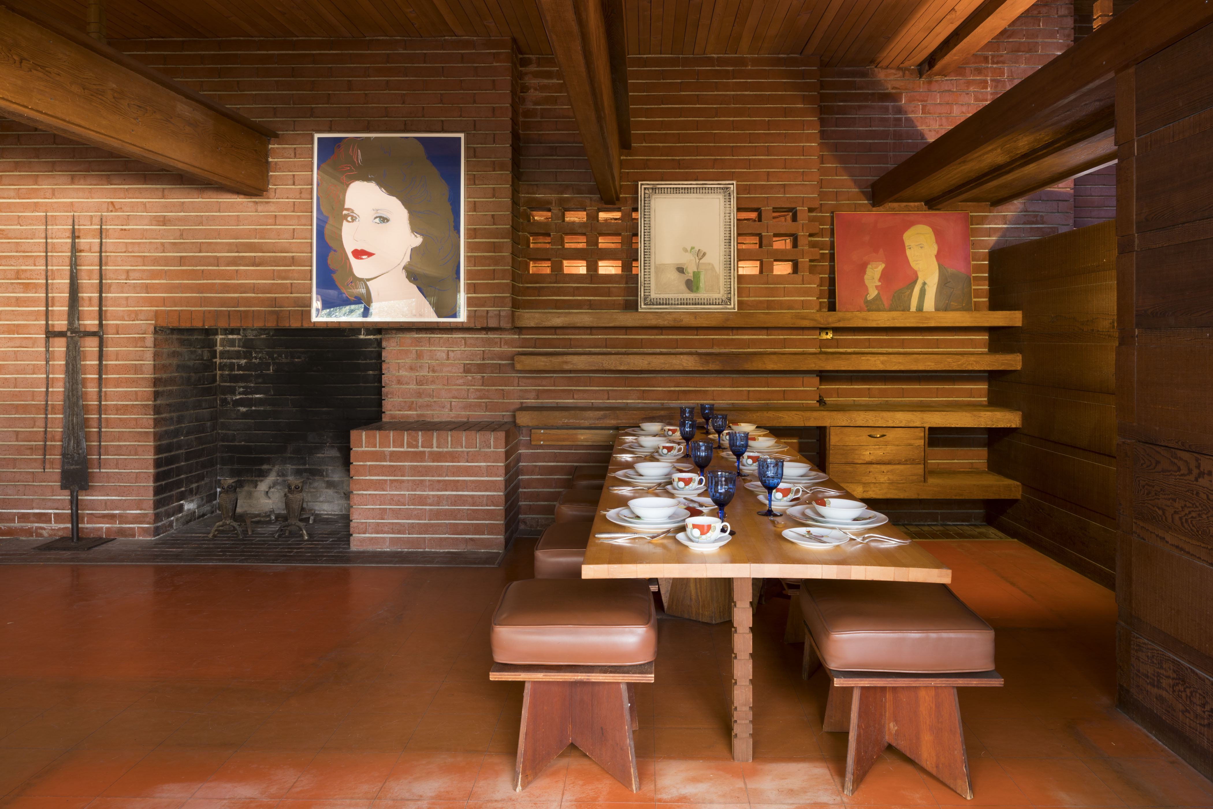 Interior of Living-Dining area. Left to right: Works of art by Oliver Andrews, Andy Warhol, David Hockney, and Alex Katz. China by Frank Lloyd Wright.