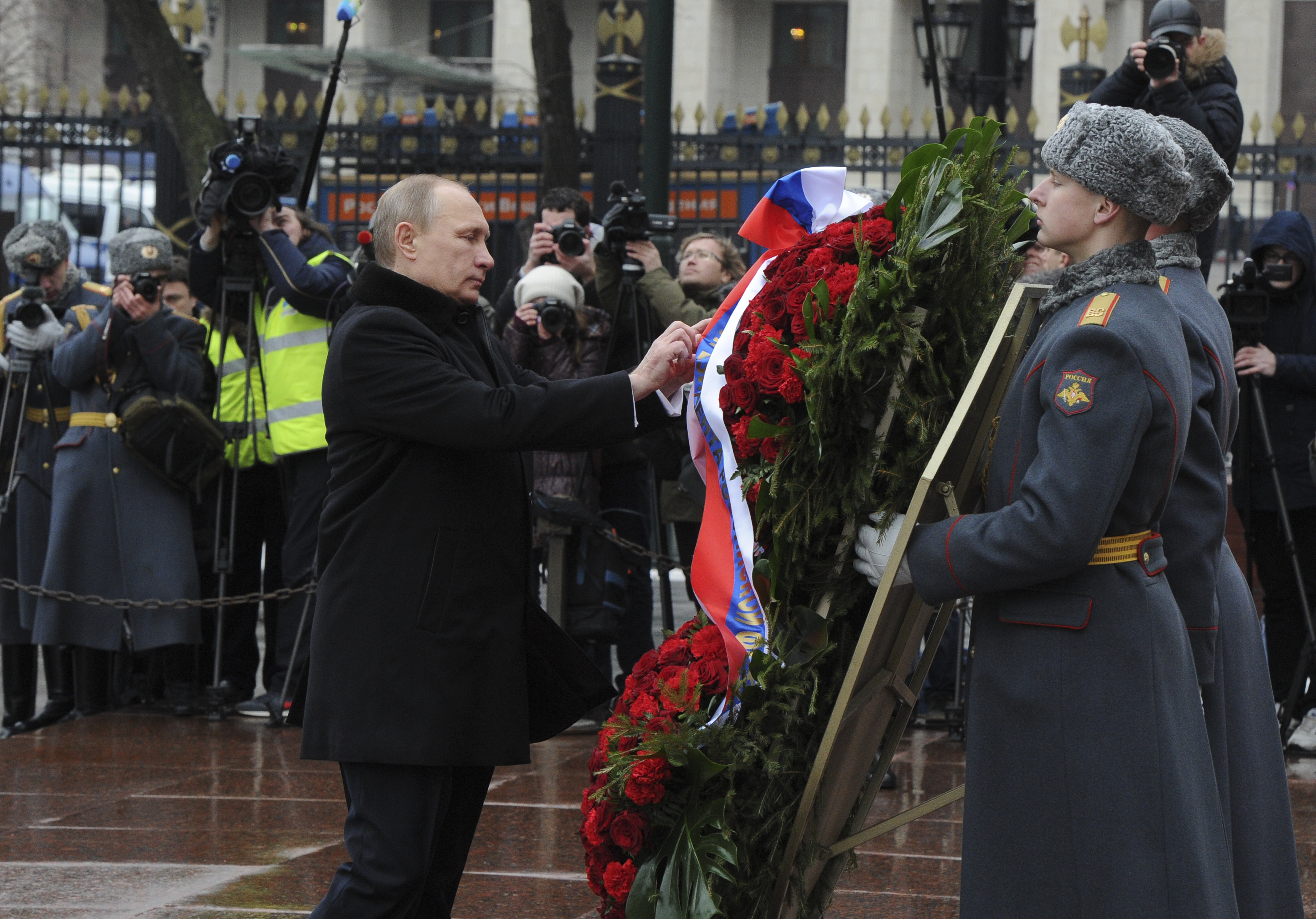 Russian President Putin attends a wreath laying ceremony to mark the Defender of the Fatherland Day in Moscow