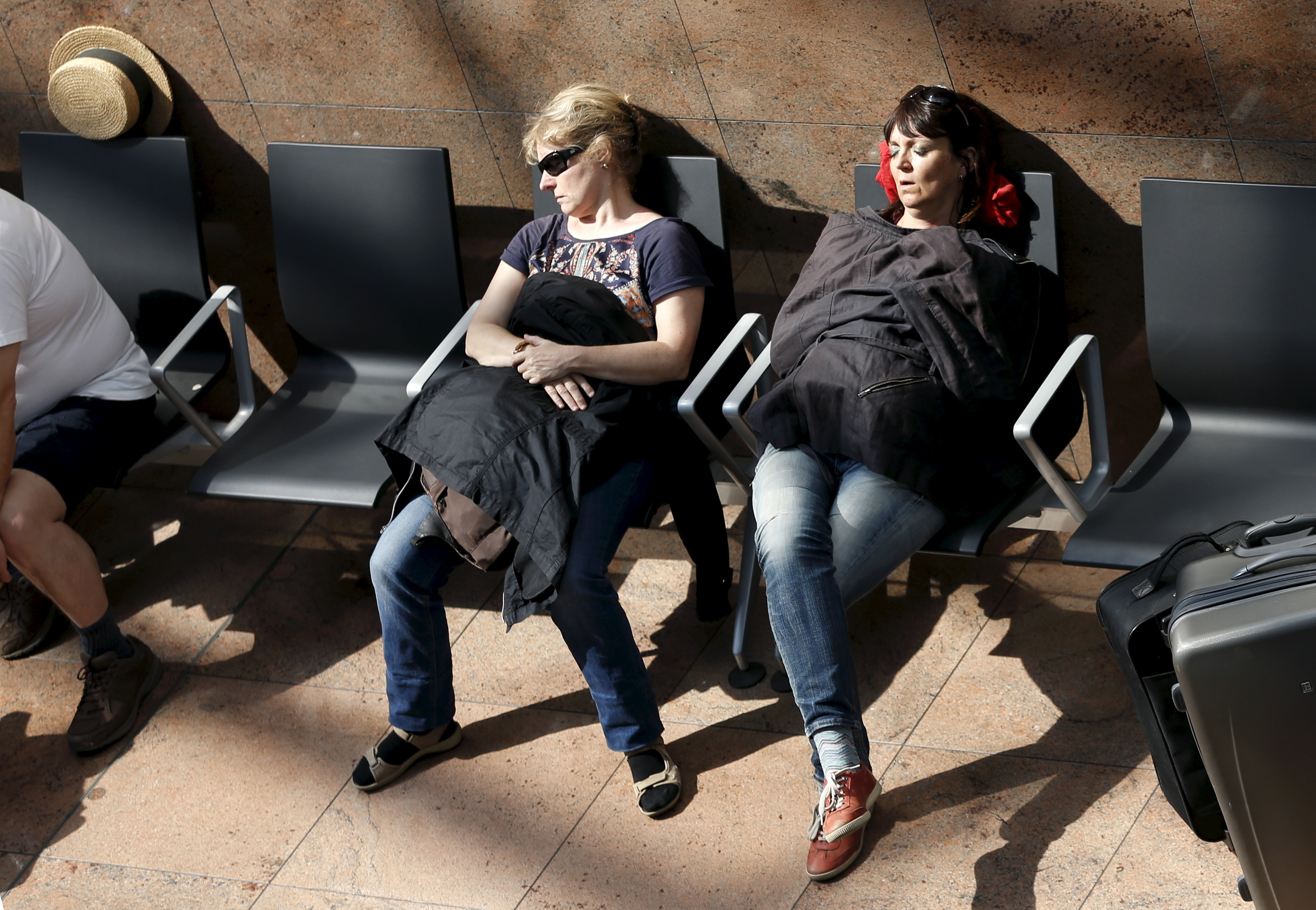 Stranded passengers sleep at Zaventem international airport near Brussels