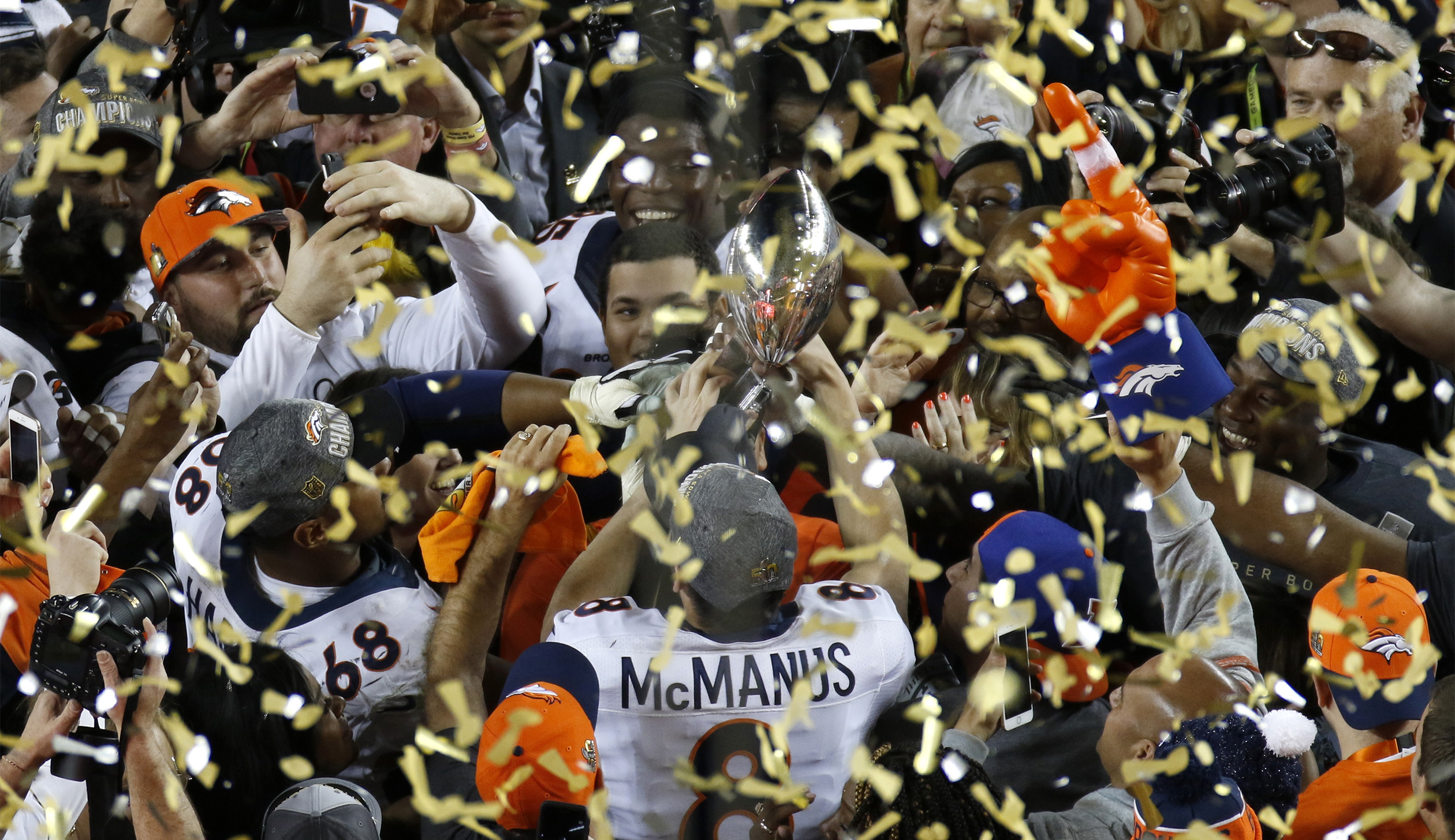 Denver Broncos' Brandon McManus holds the Vince Lombardi Trophy after the Broncos defeated the Carolina Pathers in the NFL's Super Bowl 50 football game in Santa Clara