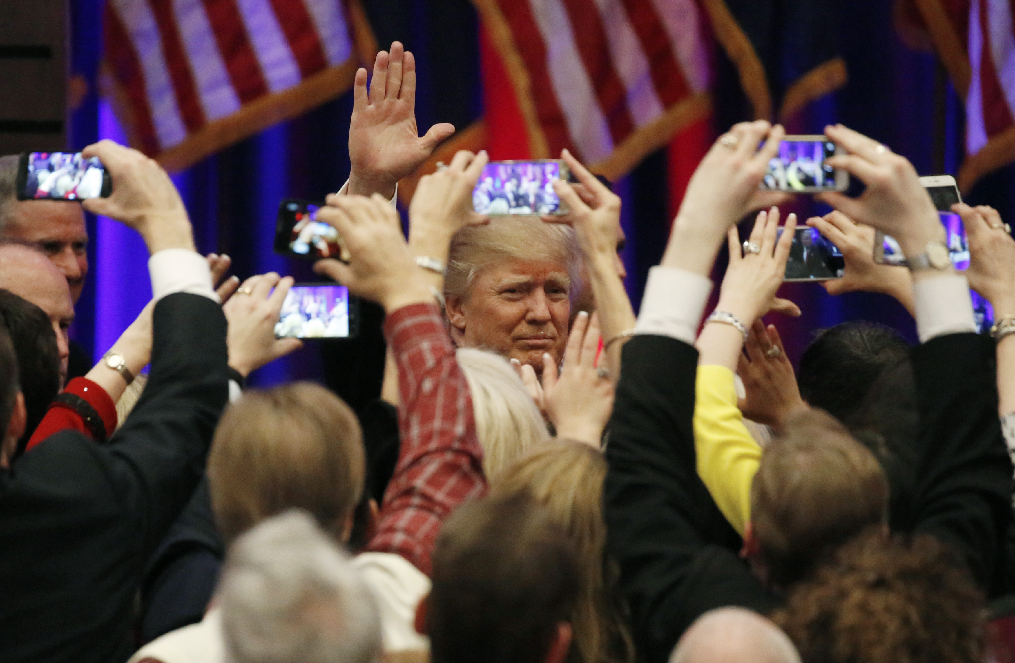 Republican U.S. presidential candidate Donald Trump greets supporters after speaking at his 2016 South Carolina presidential primary night victory rally in Spartanburg