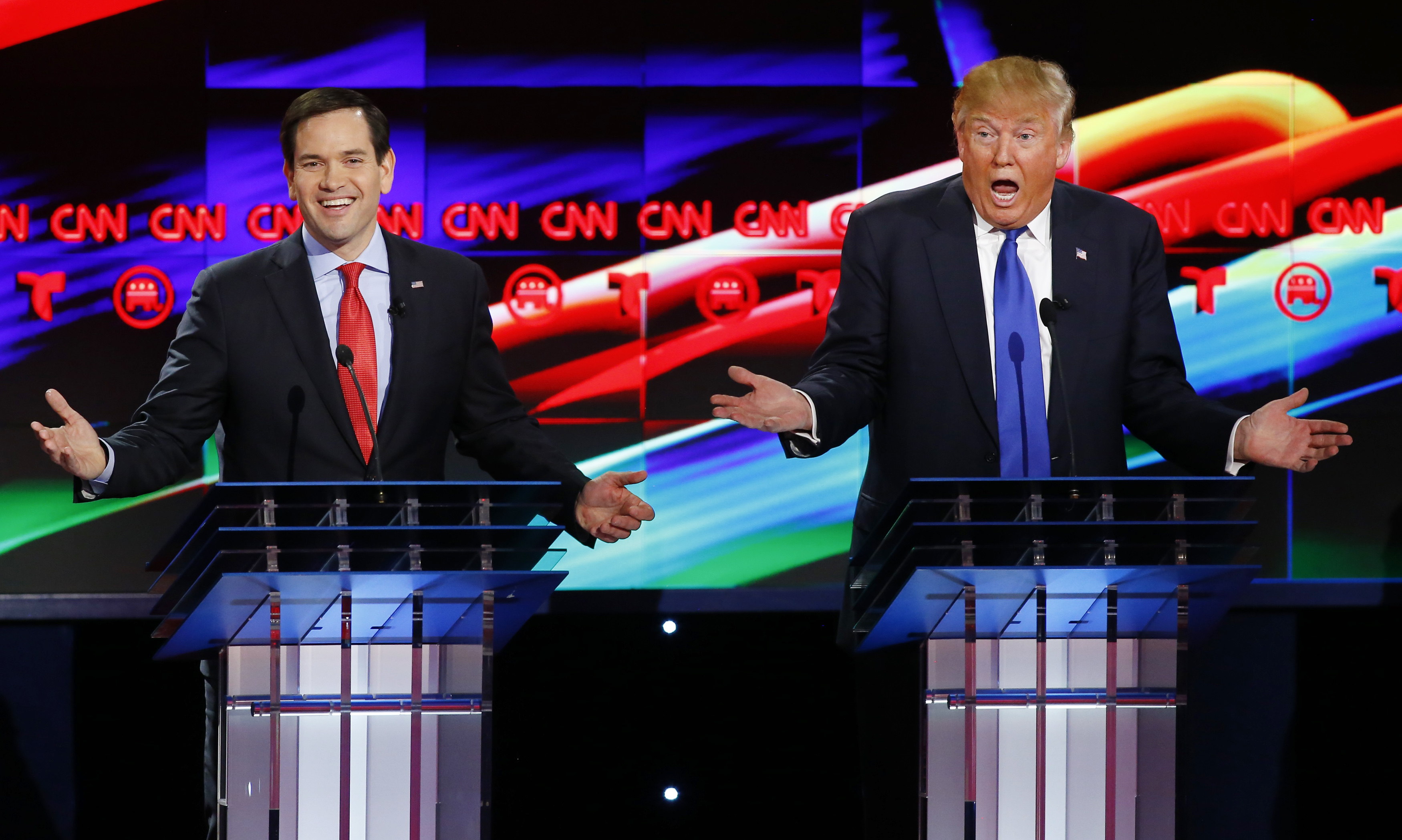 Republican U.S. presidential candidates Rubio and Trump react to each other as they discuss an issue during the debate sponsored by CNN for the 2016 Republican U.S. presidential candidates in Houston