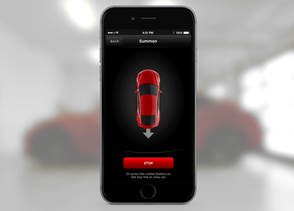 """A screenshot of """"Summon,"""" the remote self-parking feature introduced by Tesla in January 2015."""