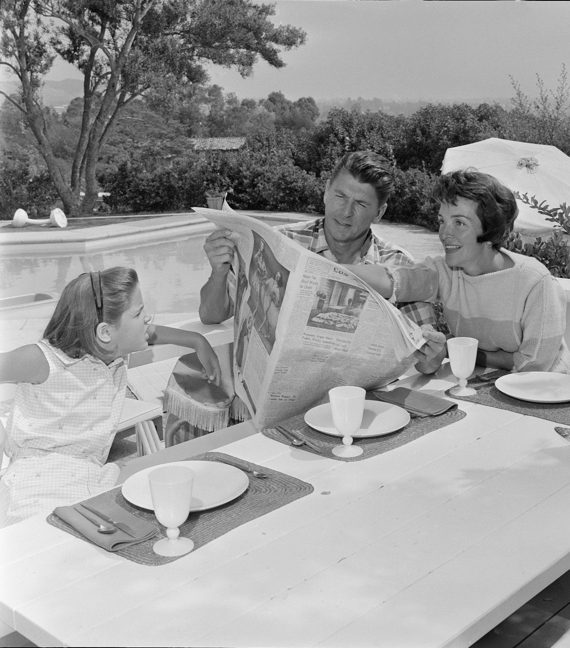 LOS ANGELES - SEPTEMBER 16:  Ronald Reagan at home in Pacific Palisades with his wife Nancy Davis Reagan and their daughter, Patricia Ann, age 9  (Photo by CBS via Getty Images) *** Local Caption *** Ronald Reagan;Nancy Davis Reagan;Patricia Ann Reagan