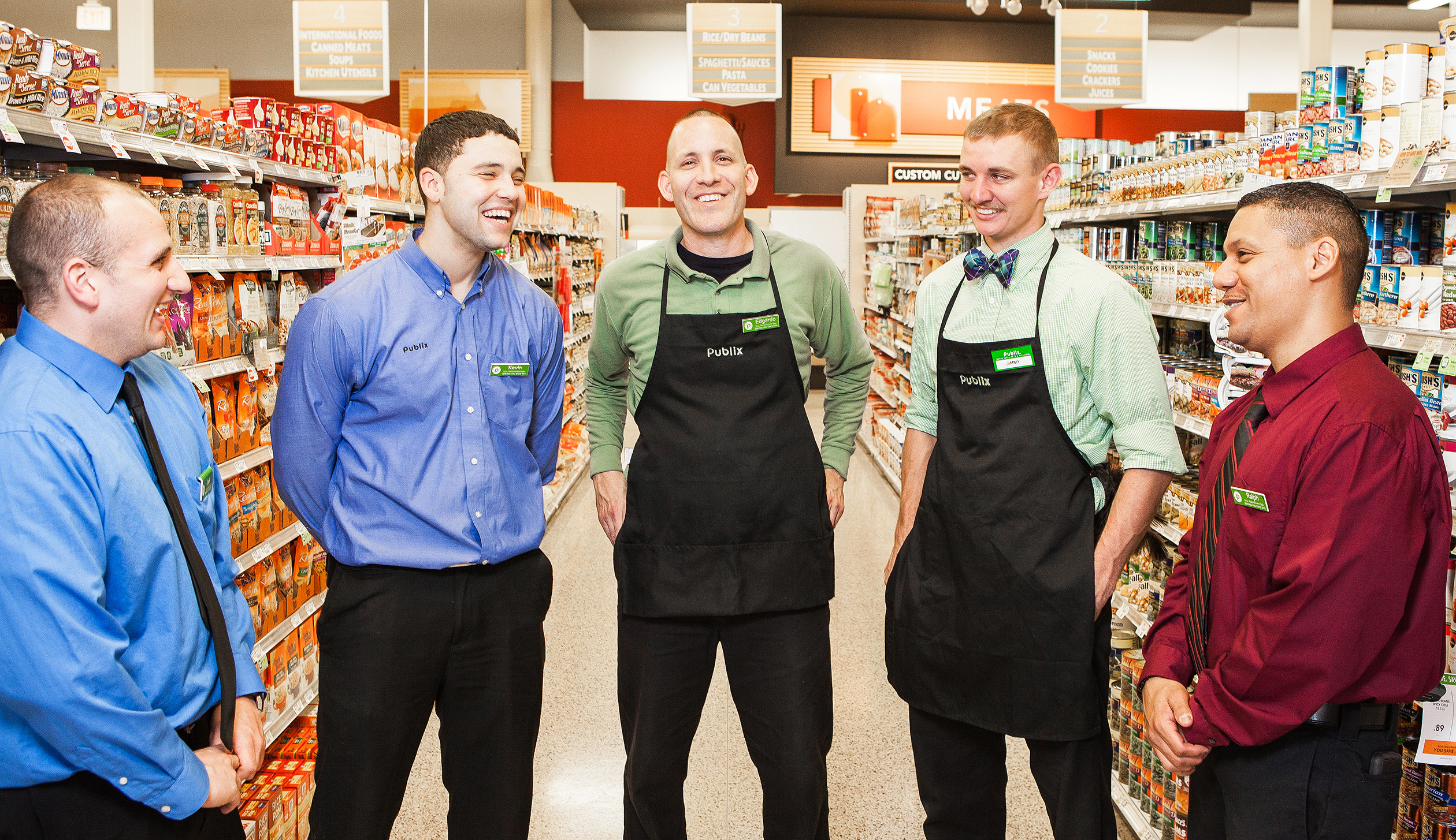 Associates at Publix Super Markets gather for a quick huddle during the workday.