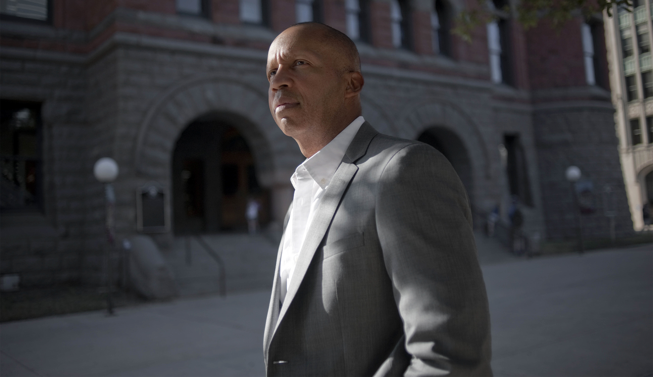 Bryan Stevenson, who founded and runs the Equal Justice Initiative, in front of the former courthouse where the 1910 lynching of Allen Brooks, a black man, began in Dallas.