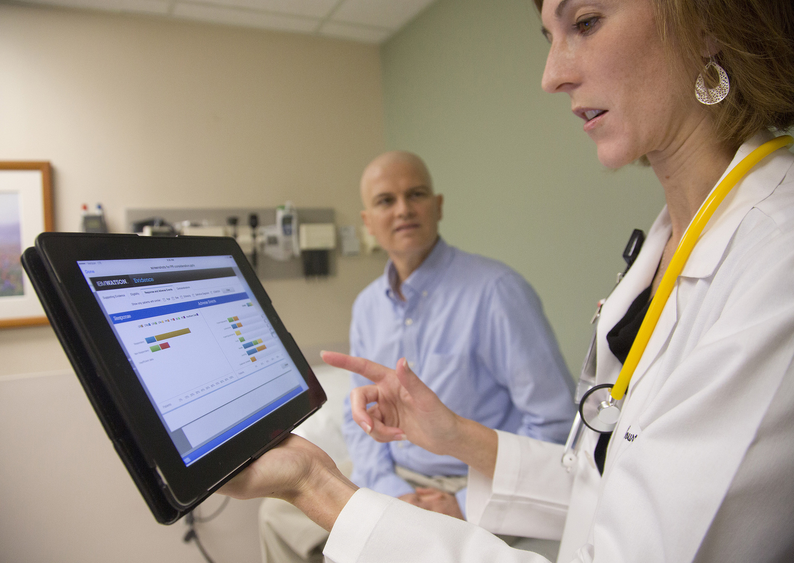 At the University of Texas MD Anderson Cancer Center, Assistant Professor of Leukemia Dr. Courtney DiNardo uses IBM's Watson cognitive system while consulting with patient Rich Ware.