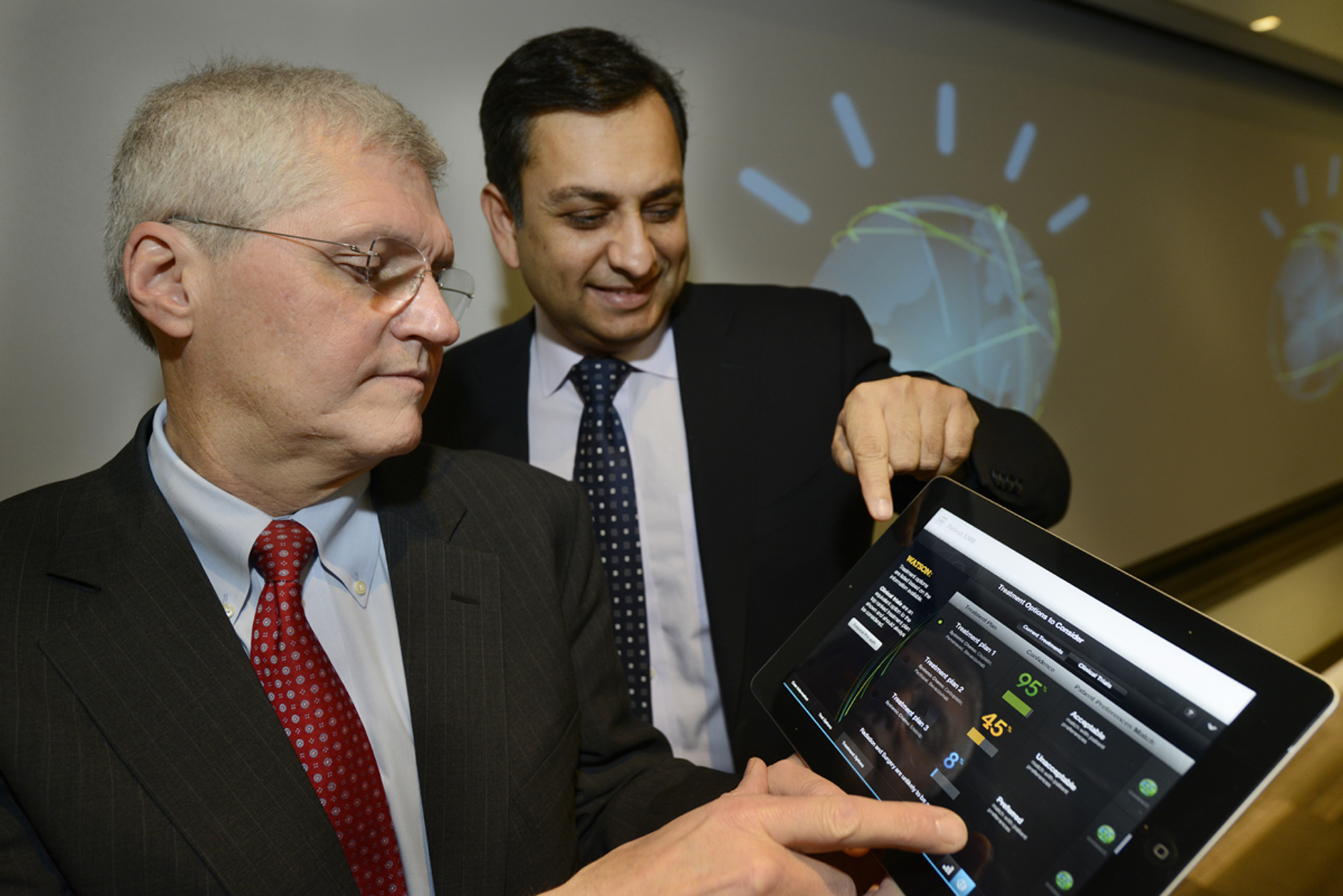 Mark Kris, MD, Chief of Thoracic Oncology, Memorial Sloan-Kettering Cancer Center, left, and Manoj Saxena, IBM General Manager, Watson Solutions work with the first Watson-based cognitive computing solution for oncology in New York City on February 11, 2013.