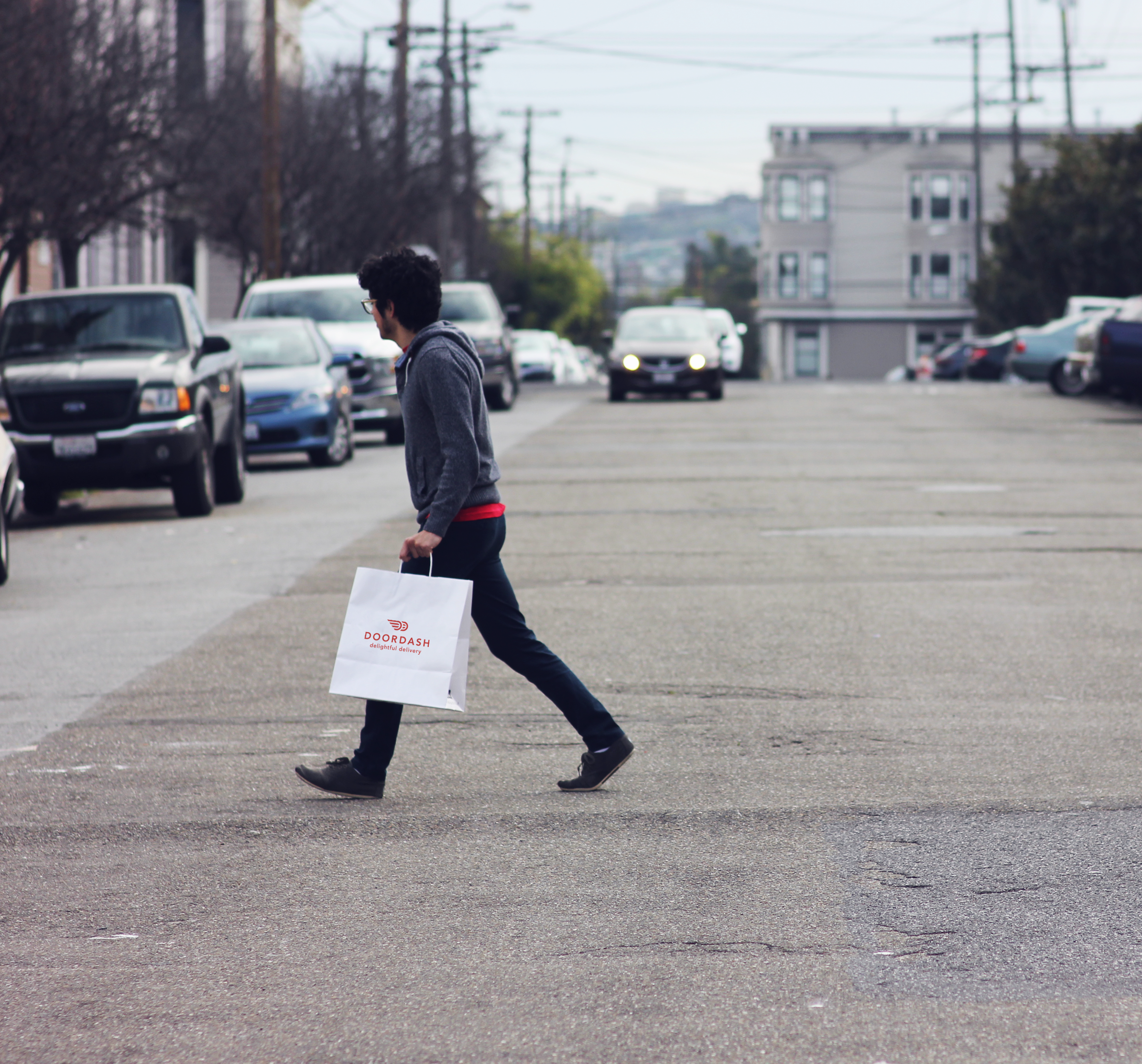 A DoorDash courier delivers a food order.