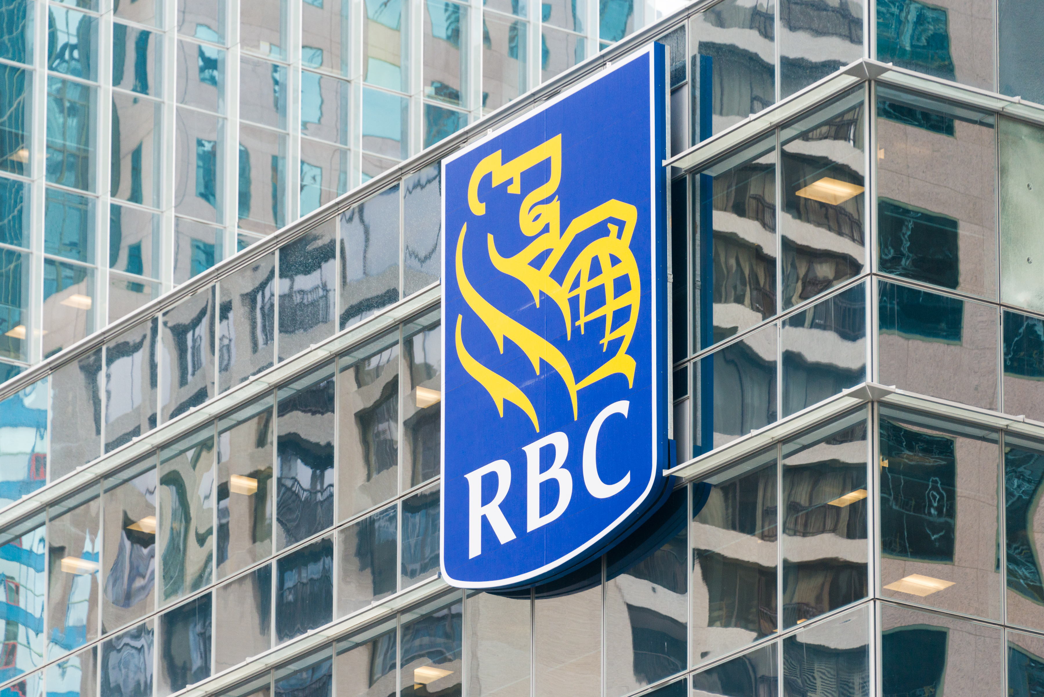 The symbol RBC on the glass facade of a building. The Royal