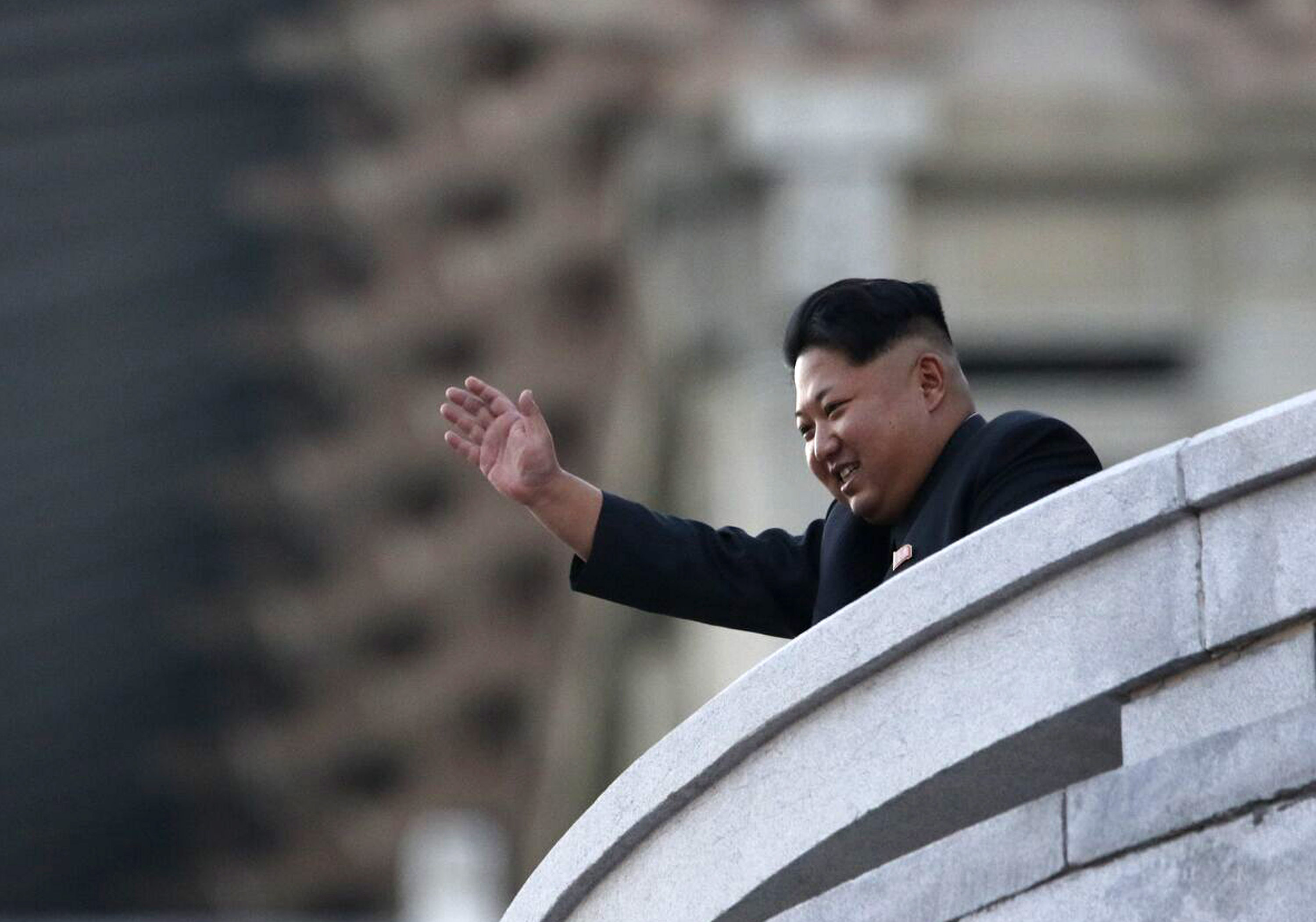 PYONGYANG, NORTH KOREA - OCTOBER 10: (CHINA OUT) North Korea's leader Kim Jong-Un waves from a balcony towards participants of a mass military parade at Kim Il-Sung square to mark the 70th anniversary of its ruling Worker's Party of Korea on October 10, 2015 in Pyongyang, North Korea.  (Photo by ChinaFotoPress/ChinaFotoPress via Getty Images)