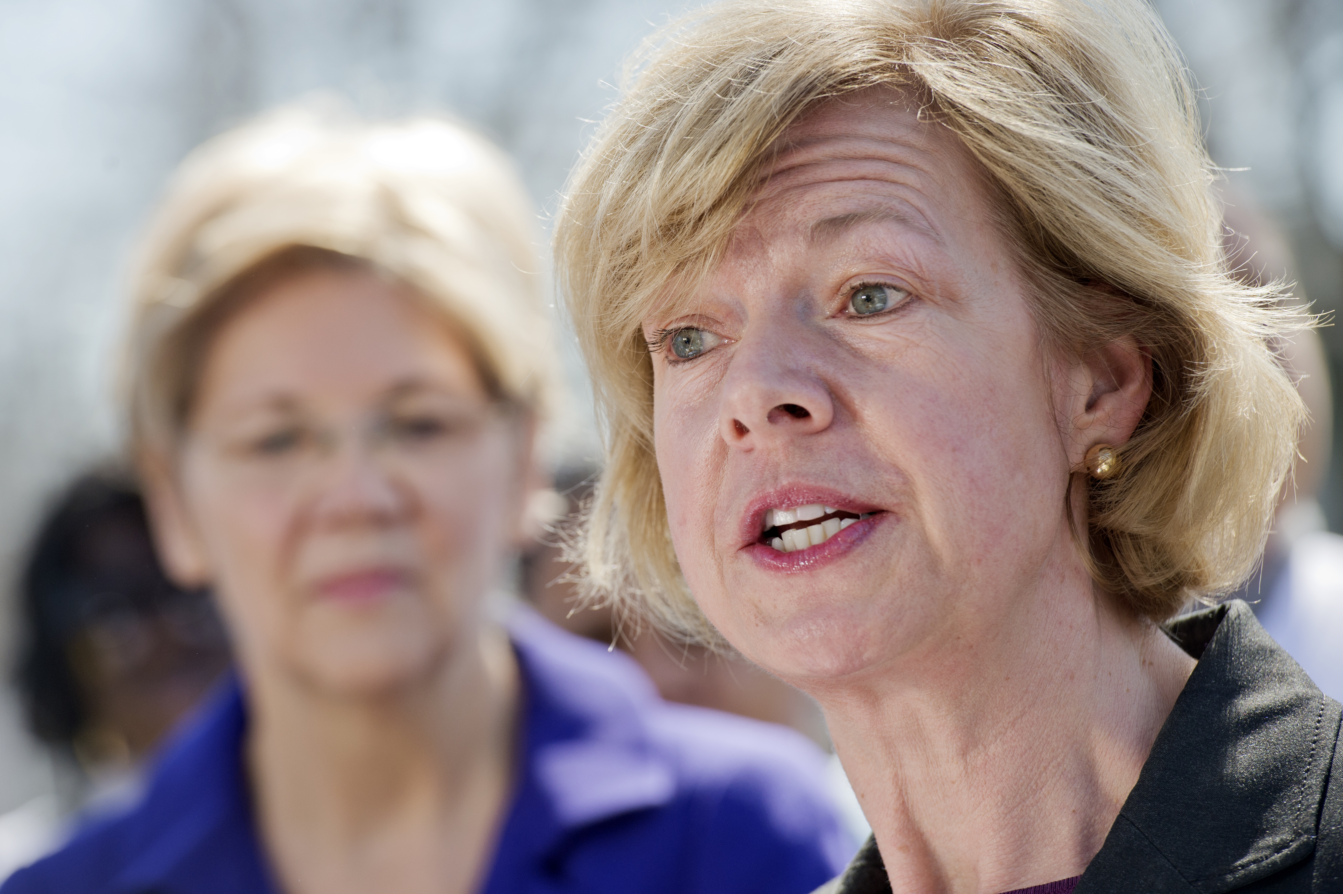 Sens. Tammy Baldwin, D-Wis. and Elizabeth Warren, D-Mass., conduct a rally on the east lawn of the Capitol on March 9, 2016.