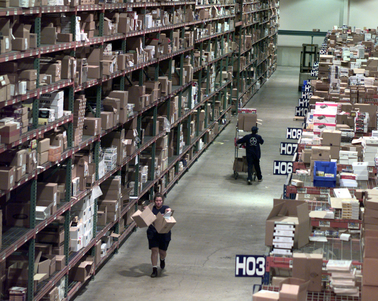 FI.Ingram.shelves.D.072298.KRH––Warehouse workers pick up orders for games, software, hard drives an