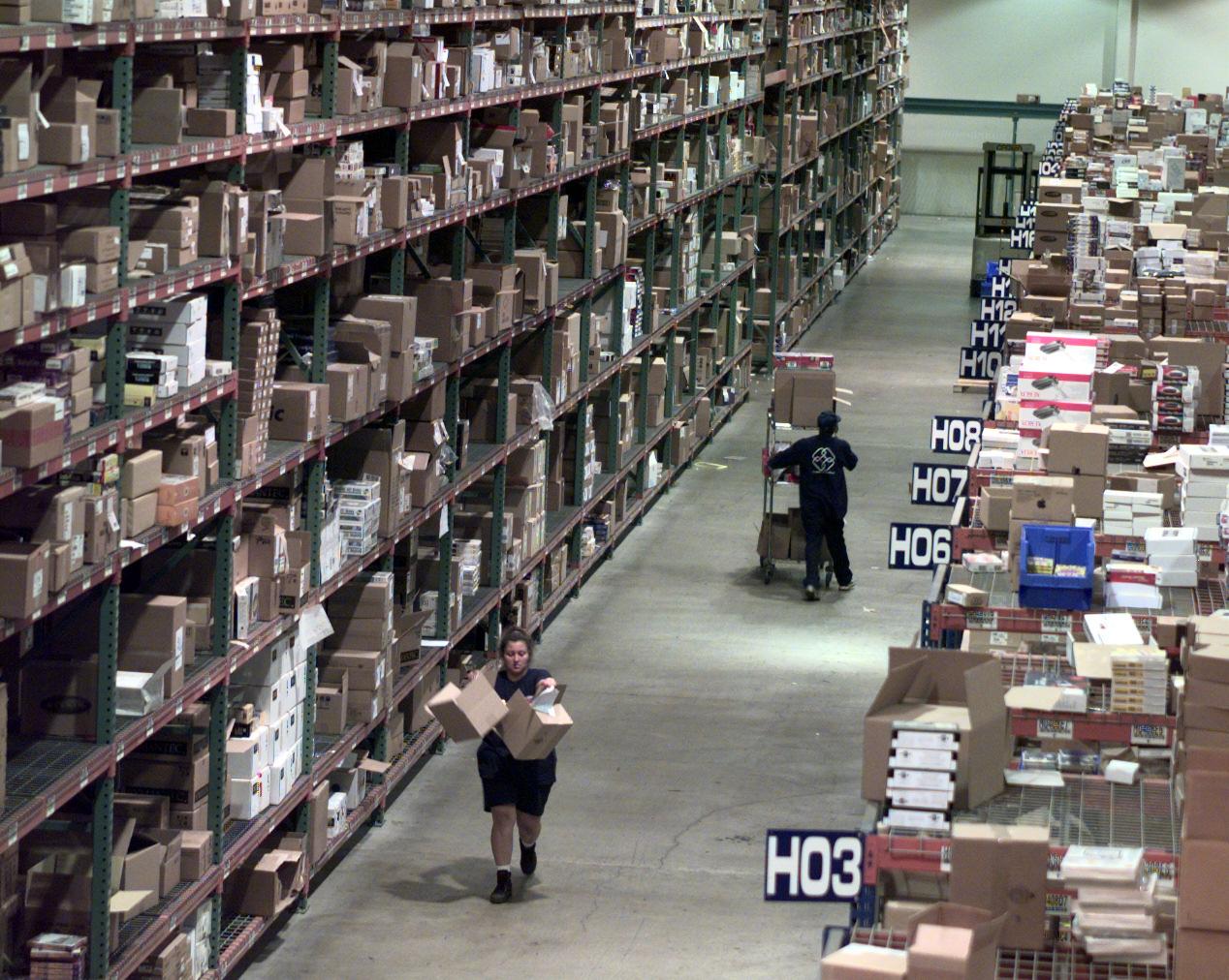 FI.Ingram.shelves.D.072298.KRH––Warehouse workers pick up orders for games, software, hard drives an