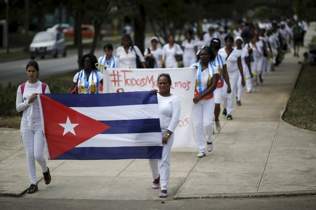 Members of the 'Ladies in White' dissident group march in Havana