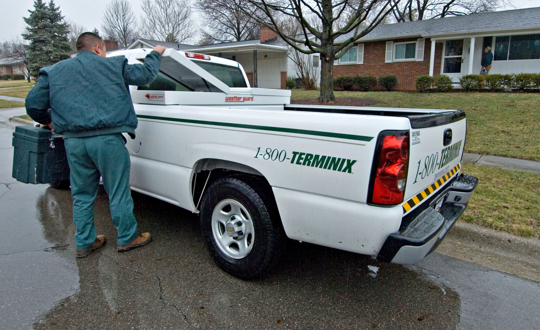 Terminix employee David Romeo pulls a work box from his truc