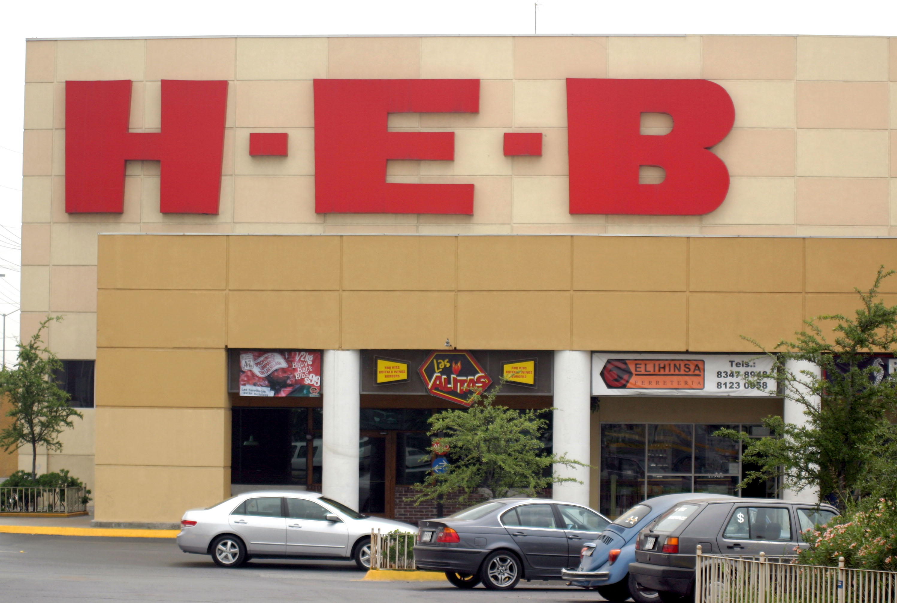 The chain's logo hangs over the entrance to an H-E-B superma