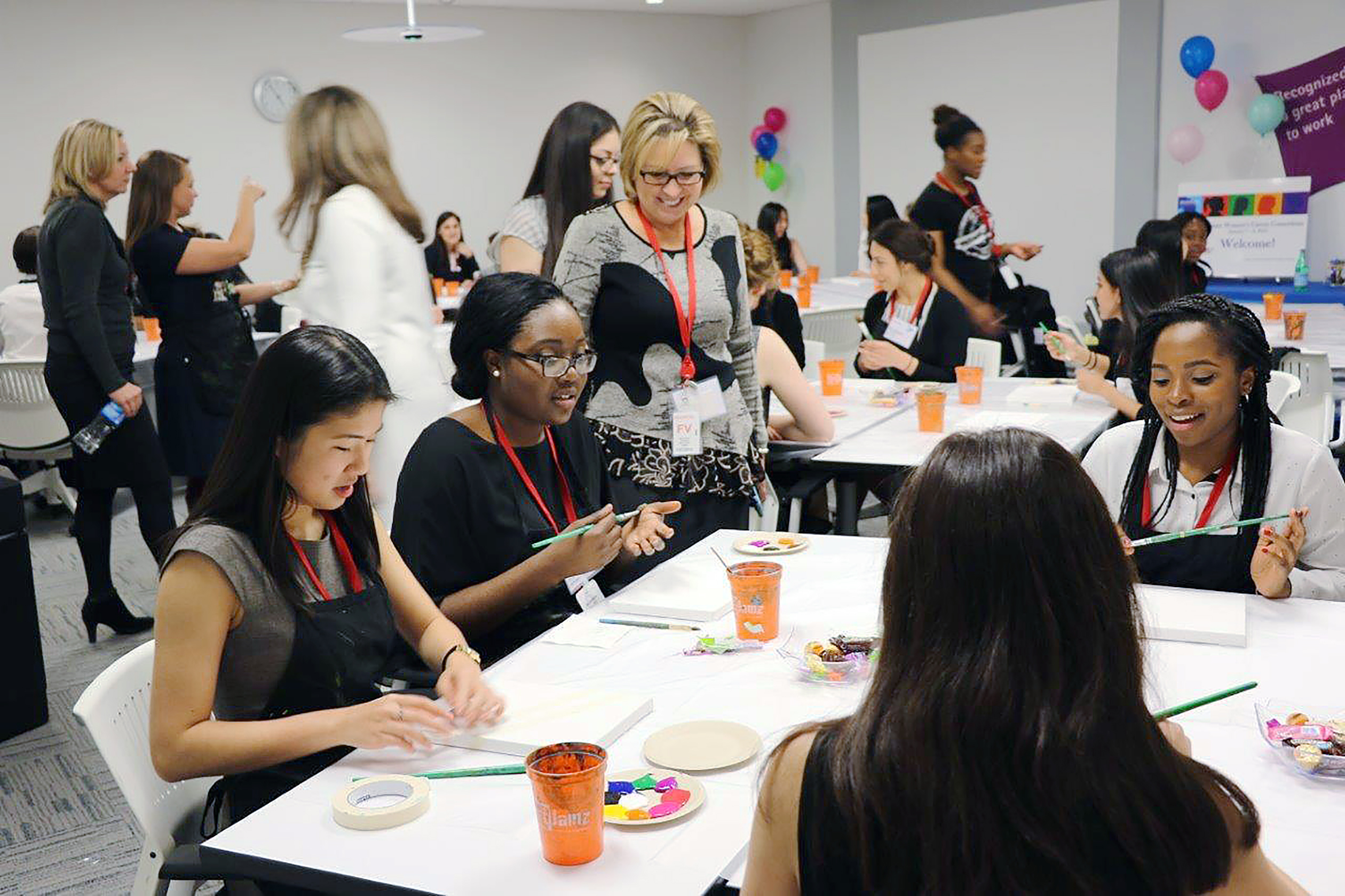 Accenture leaders and job candidates mingle at a workshop during its Women's Career Consortium in Washington, D.C.