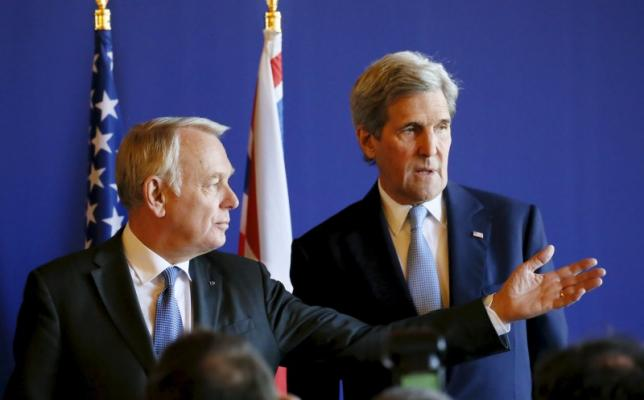 French Foreign Minister Jean-Marc Ayrault and U.S. Secretary of State John Kerry attend a news conference at the Quai d'Orsay ministry in Paris