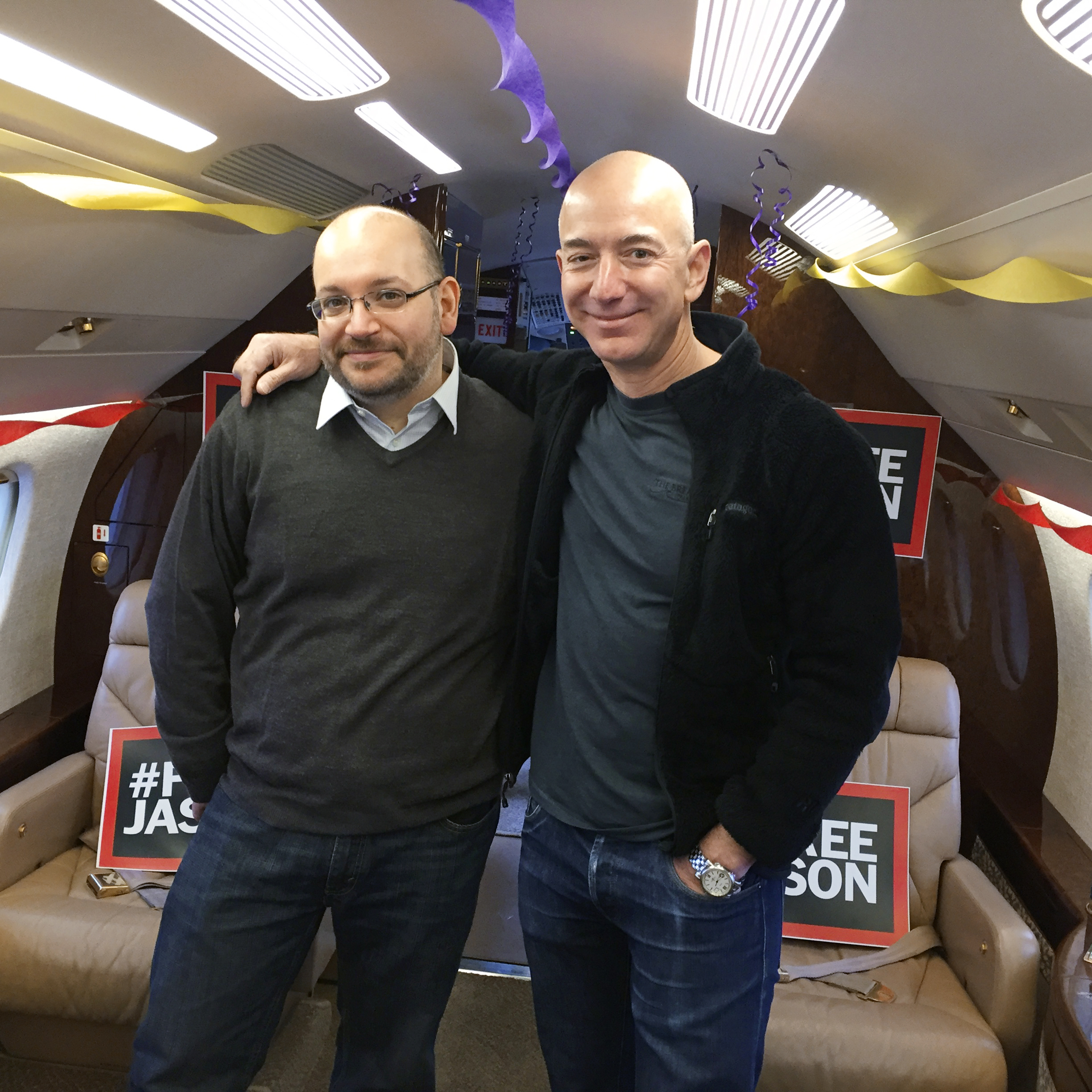 Reporter Jason Rezaian (left) and Washington Post owner Jeff Bezos aboard a private aircraft before it took off for the U.S. on Jan. 22.