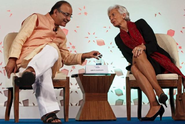 "India's Finance Minister Arun Jaitley speaks with IMF Managing Director Christine Lagarde after delivering his closing address during the ""Advancing Asia: Investing for the Future"" conference in New Delhi,"