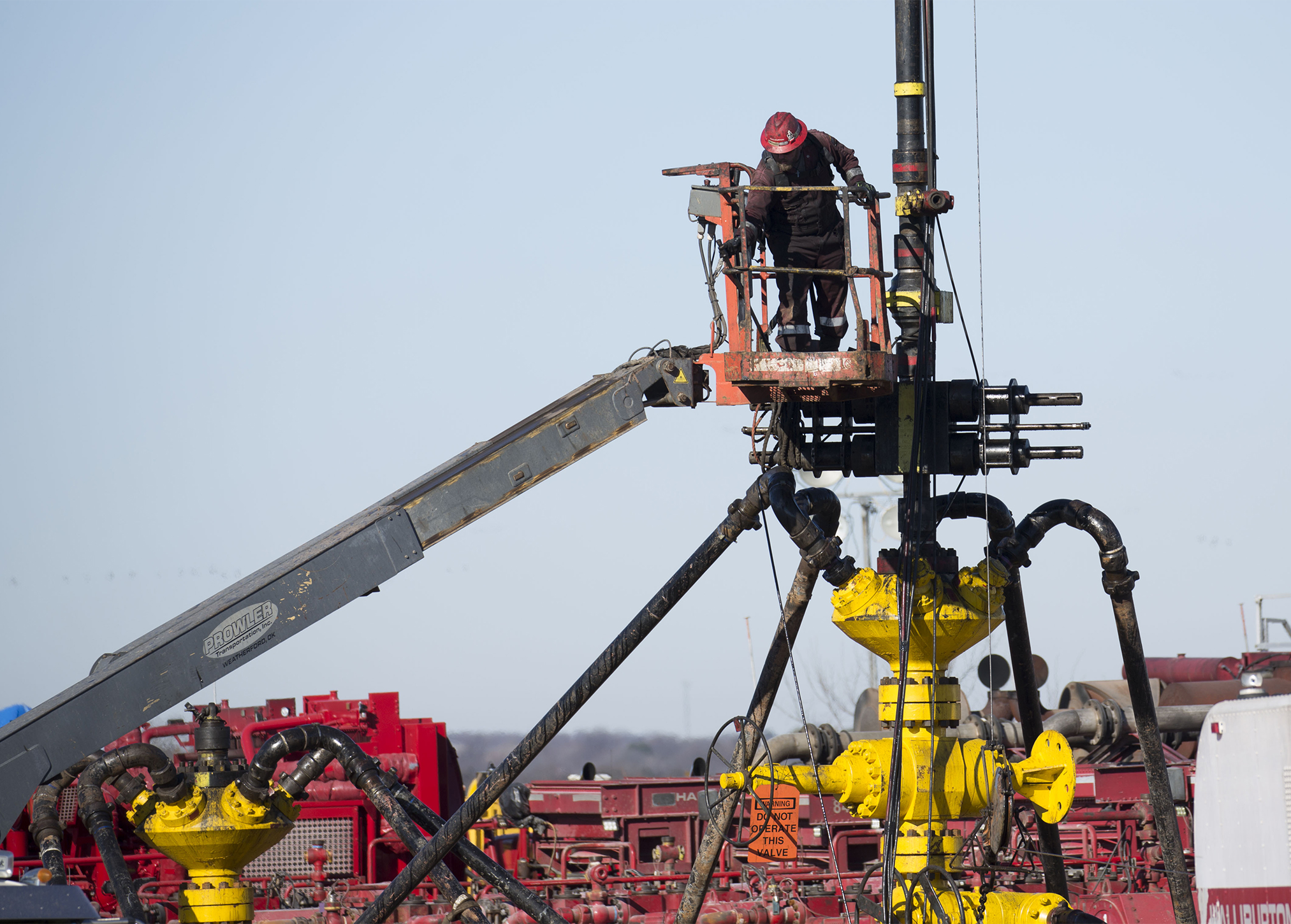 An oil well fielder works at a fracking rig site near Stillwater, Oklahoma.