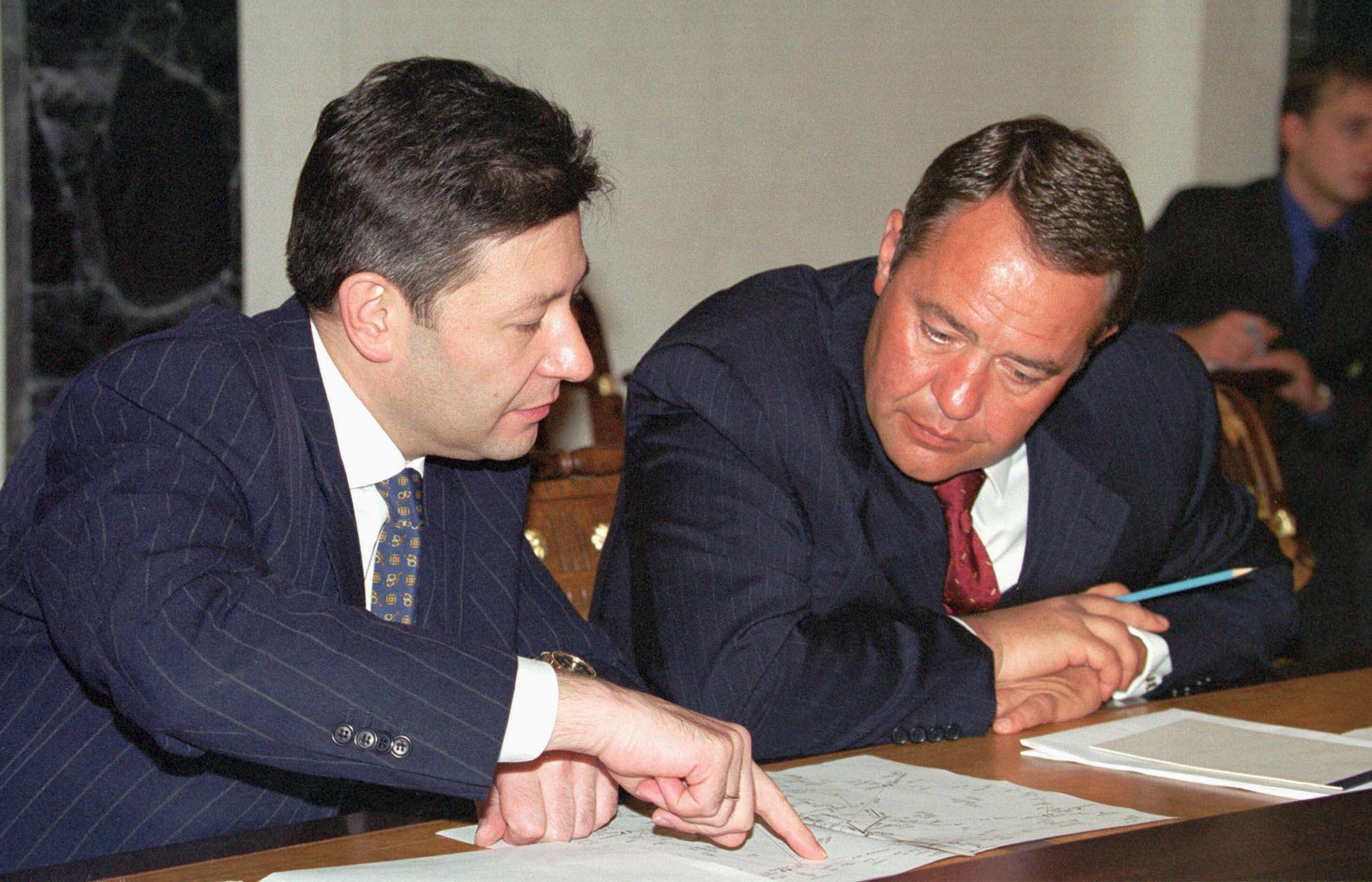 Telecommunication Minister Leonid Reiman (L) and M