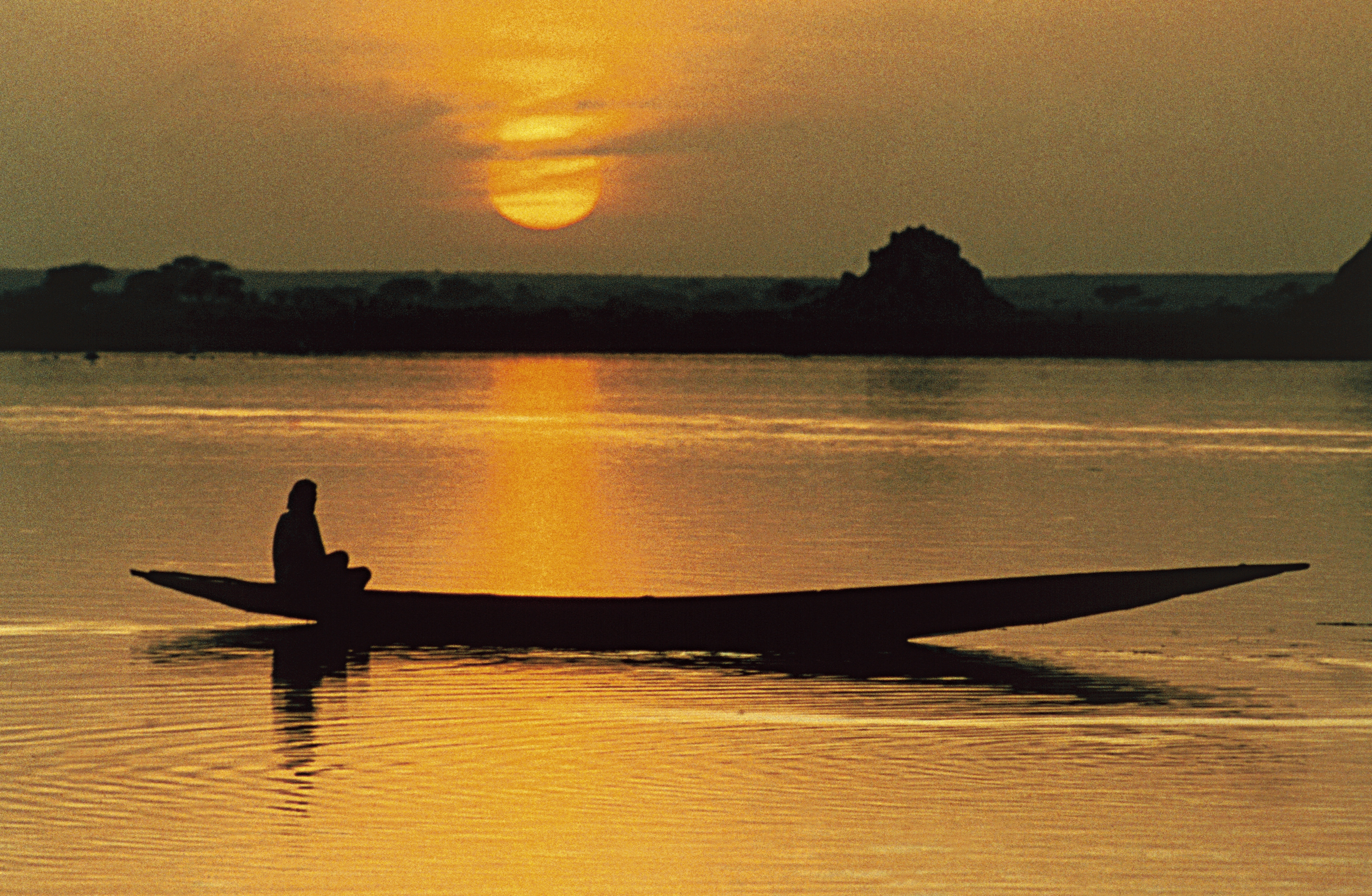 Pirogue on Niger river at sunset