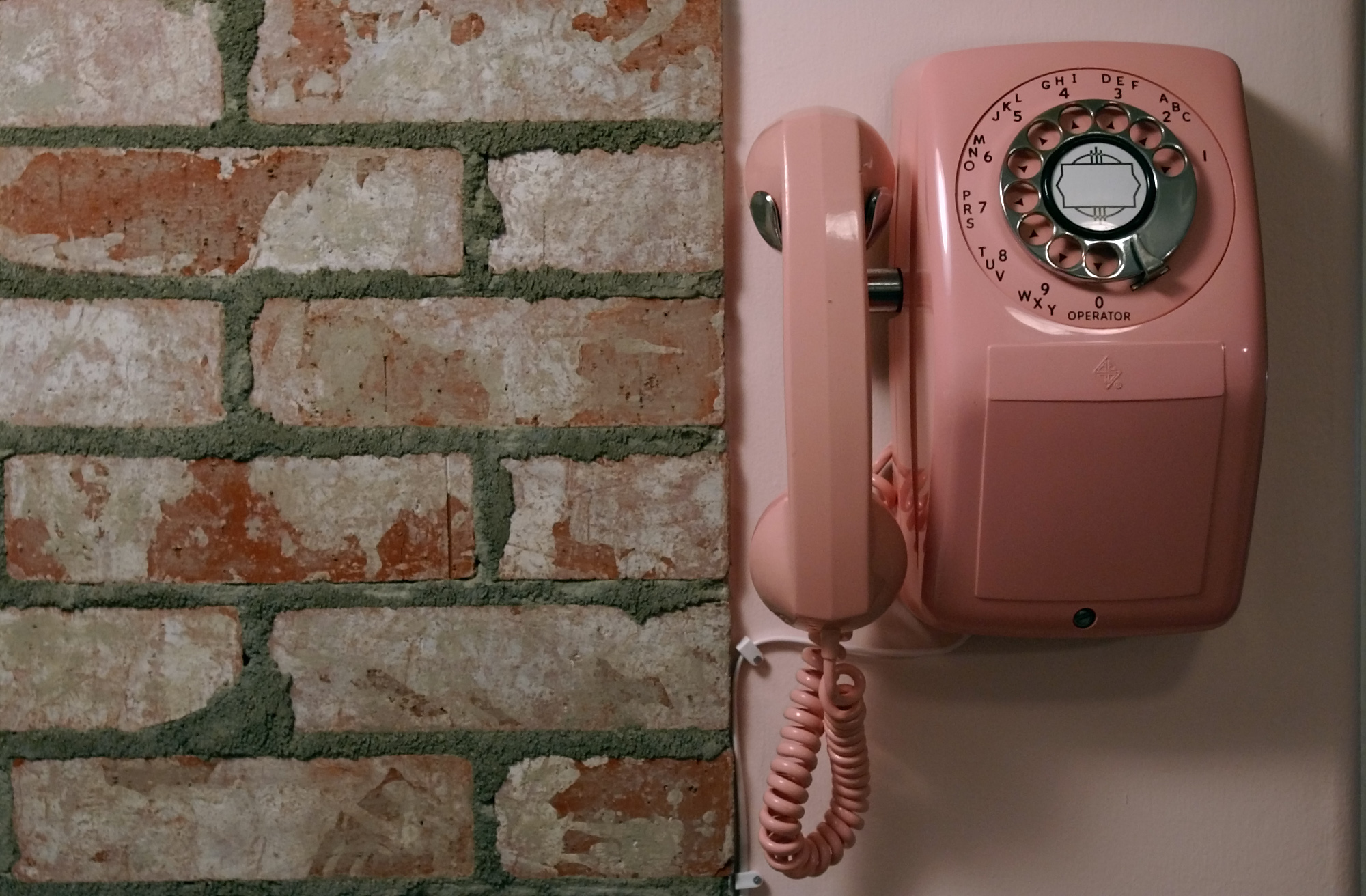Brick tiles and a rotary phone add to the 50s farmhouse kitchen feel at the Van De Yacht's home in N