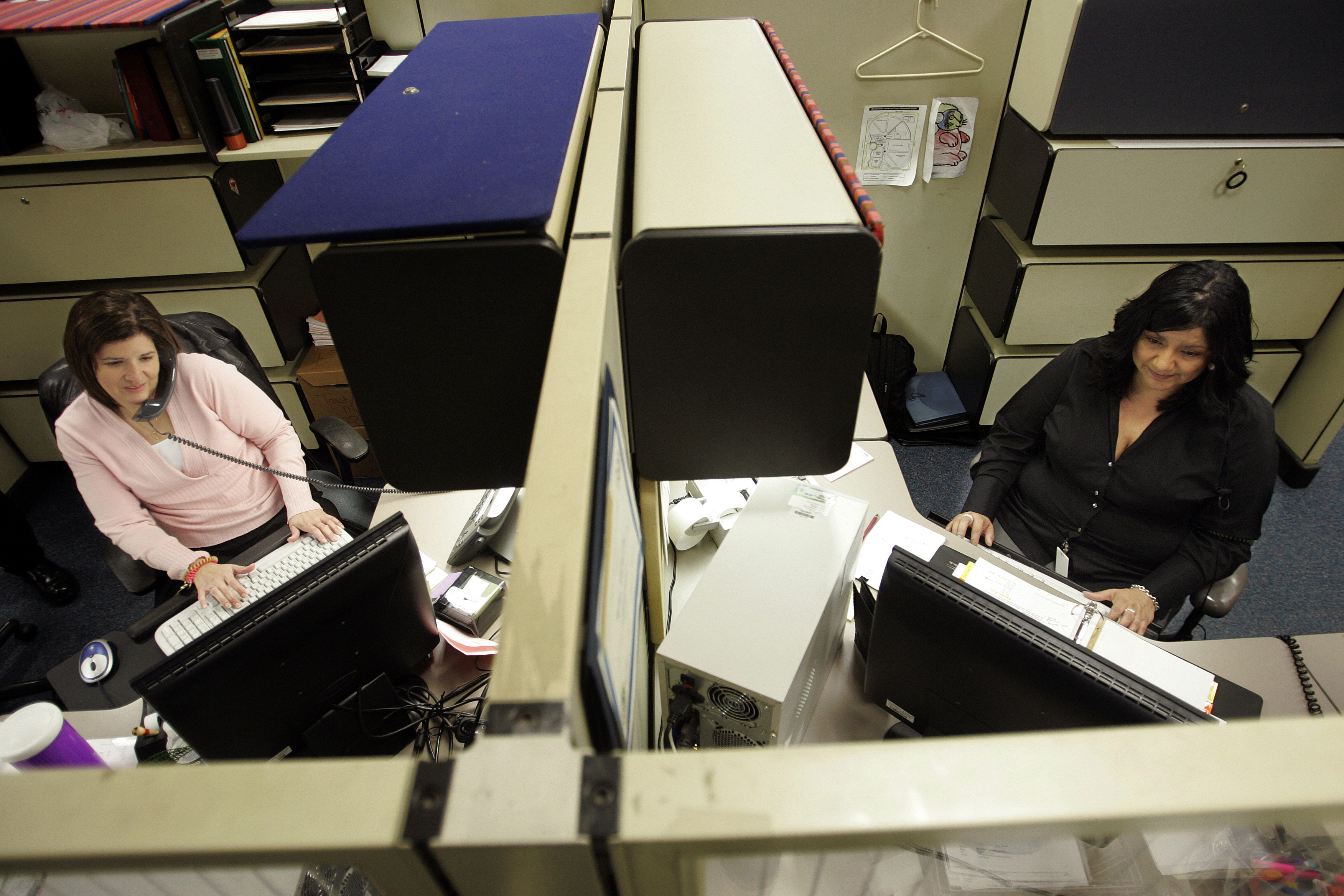 Lisa Valverde, 38, right, a fiscal assistant at the Ventura County treasury tax collector's office