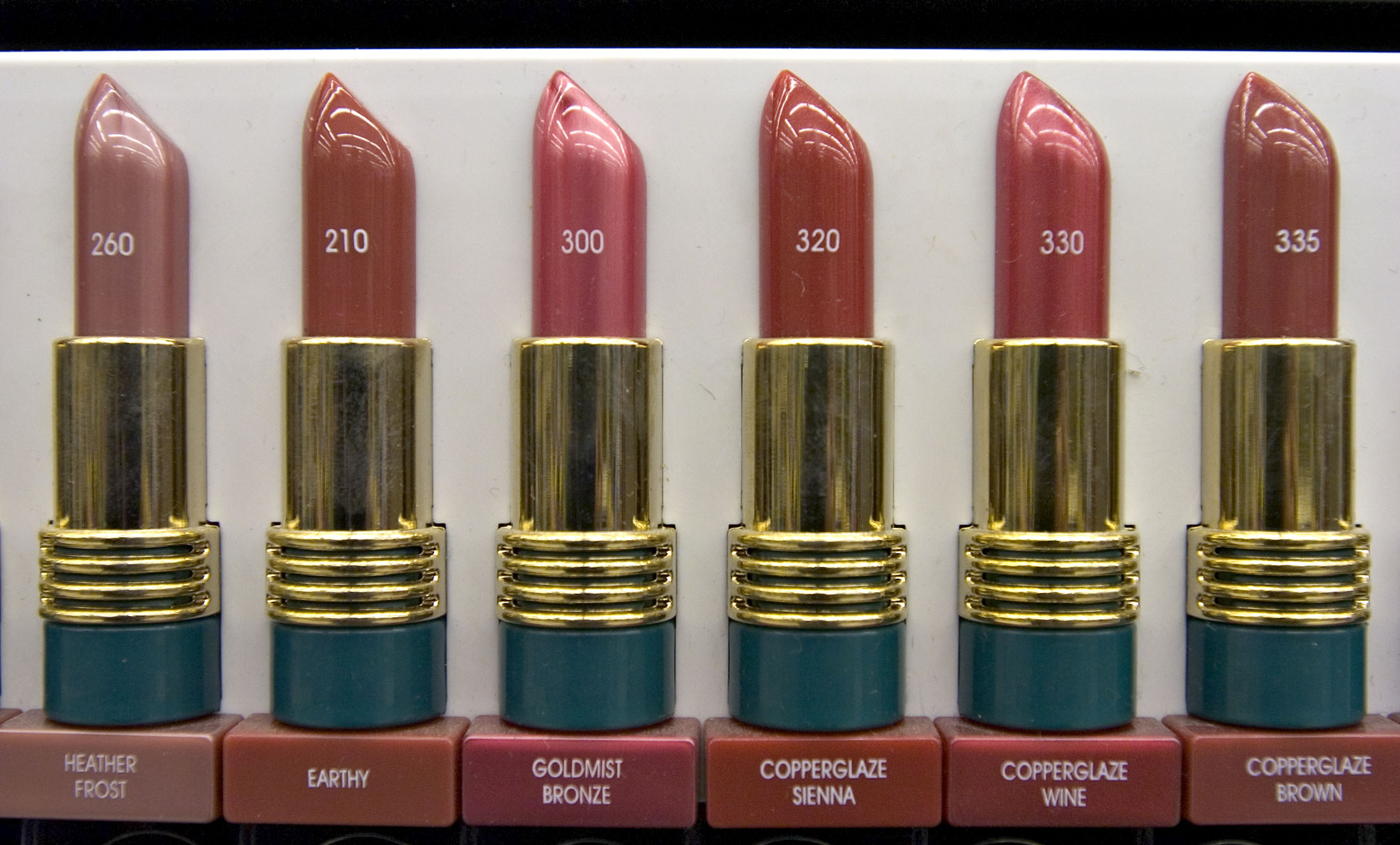 Revlon lipstick color samples are displayed in the cosmetics