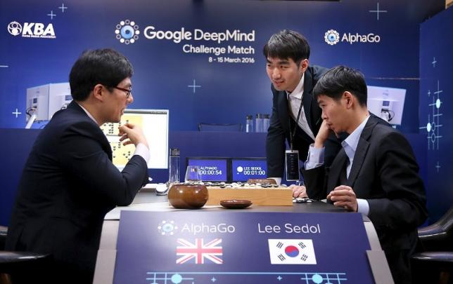 The world's top Go player Lee Sedol reviews the match after the fourth match of the Google DeepMind Challenge Match against Google's artificial intelligence program AlphaGo in Seoul