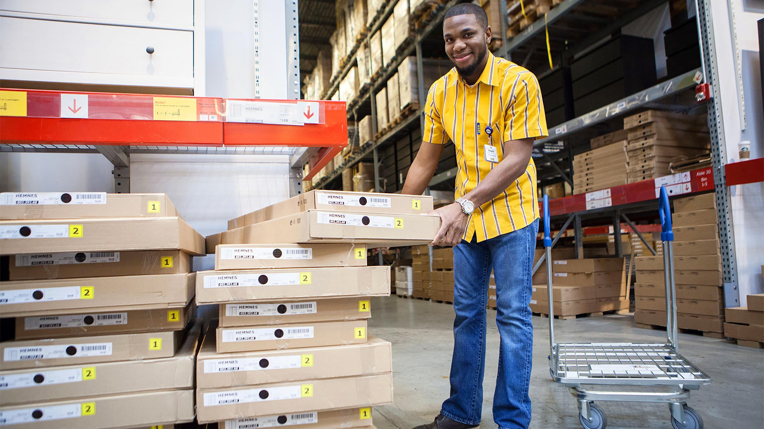 "A ""shopkeeper"" in South Philadelphia loads boxes at an Ikea self-serve warehouse."