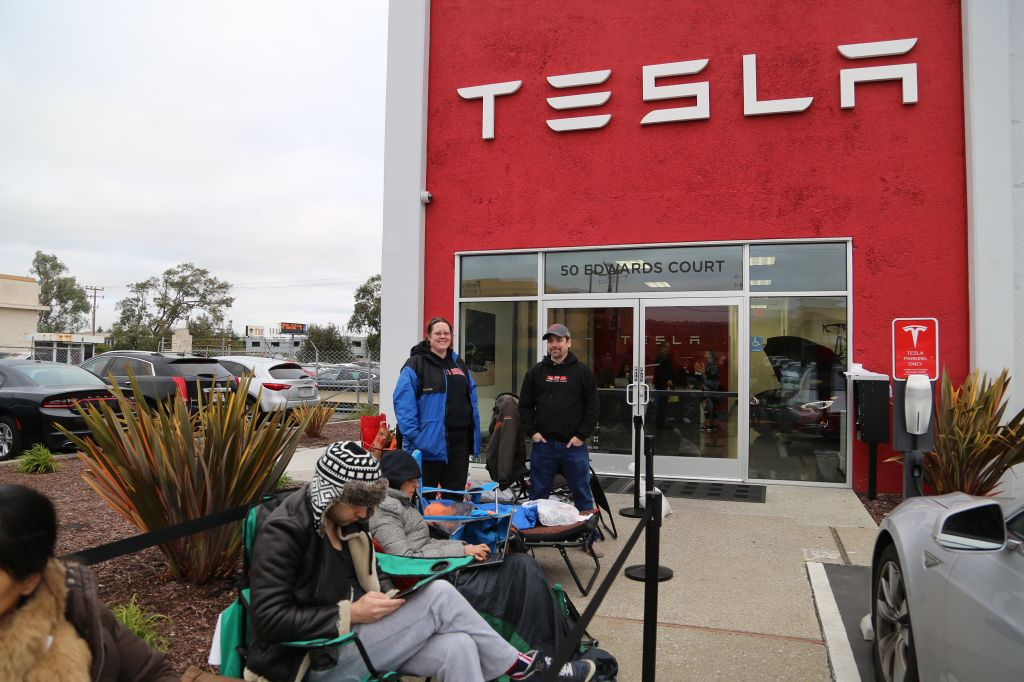 Dawn Nauhart and Brian Man camped out overnight to get on the wait list for Tesla's Model 3 car.