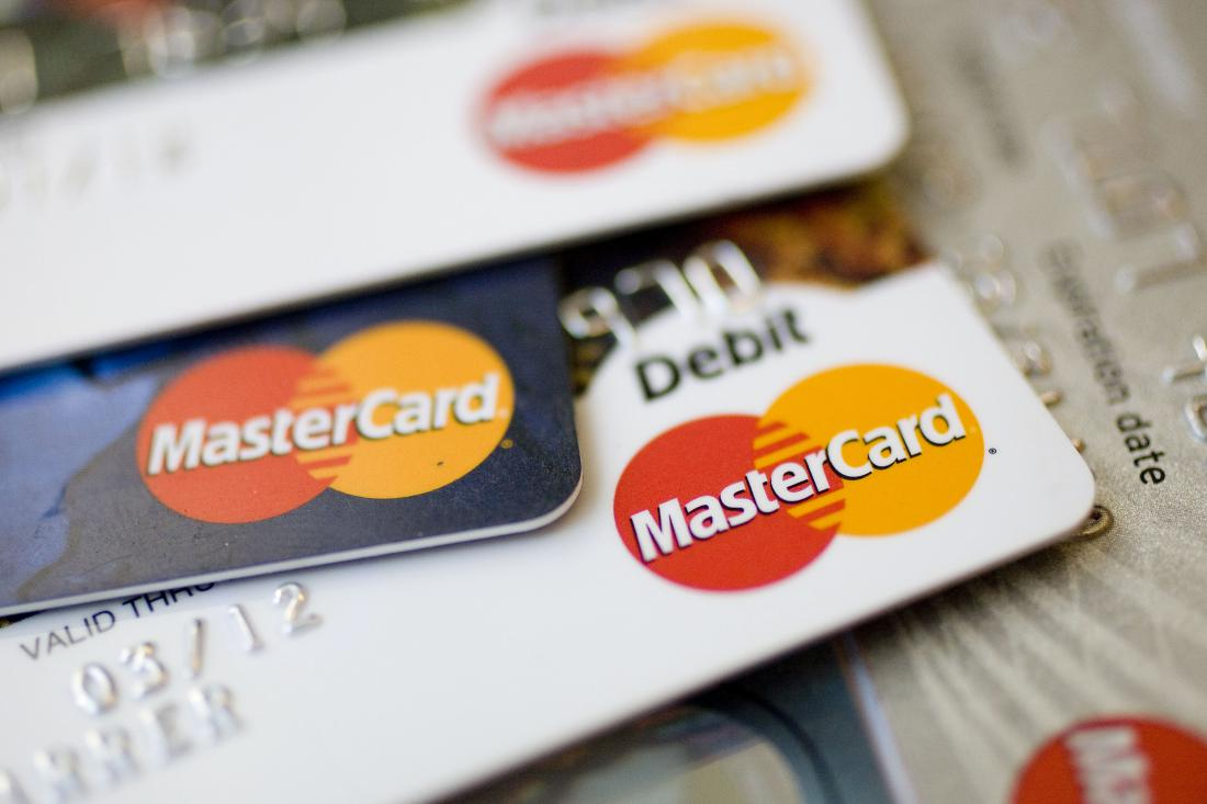 MasterCard logos appear on credit and debit cards arranged f