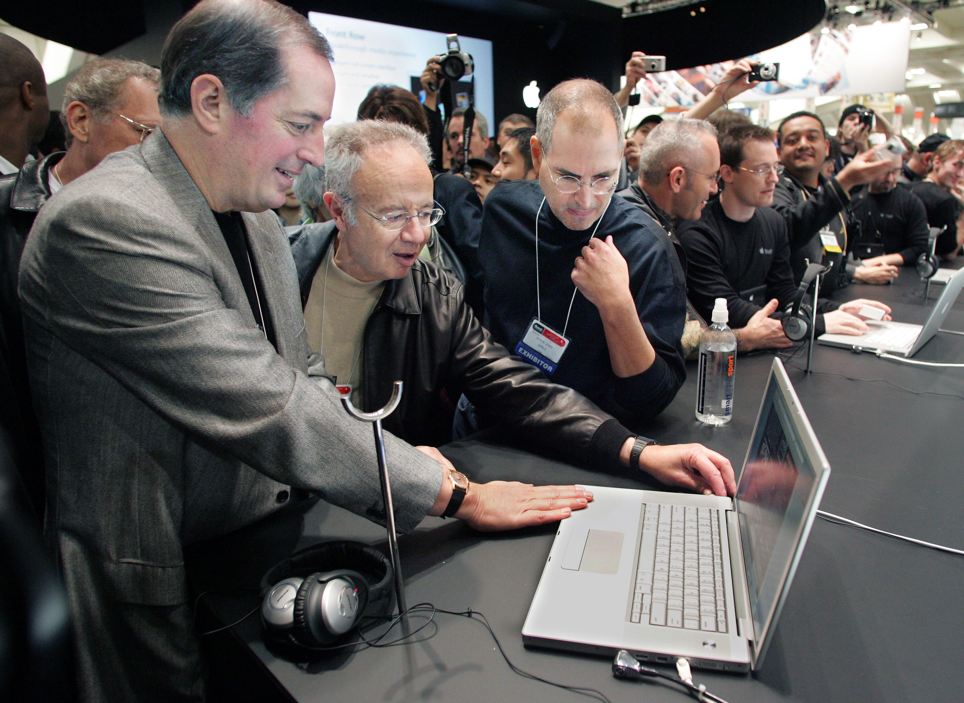 Apple CEO Jobs shows Intel CEO Otellini and former CEO Grove new MacBook Pro at Macworld