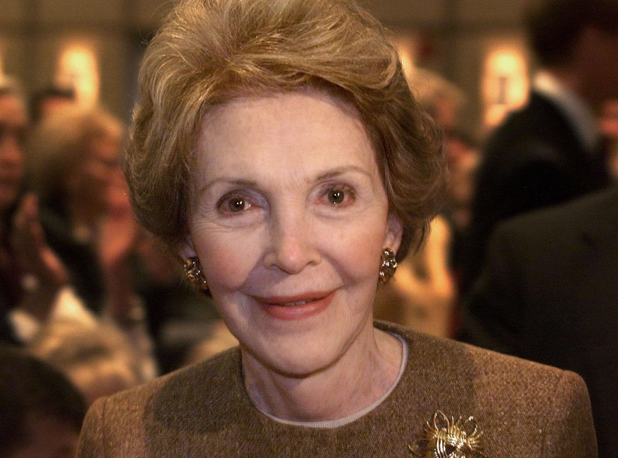 FORMER FIRST LADY NANCY REAGAN SMILES AT BUSH SPEECH.