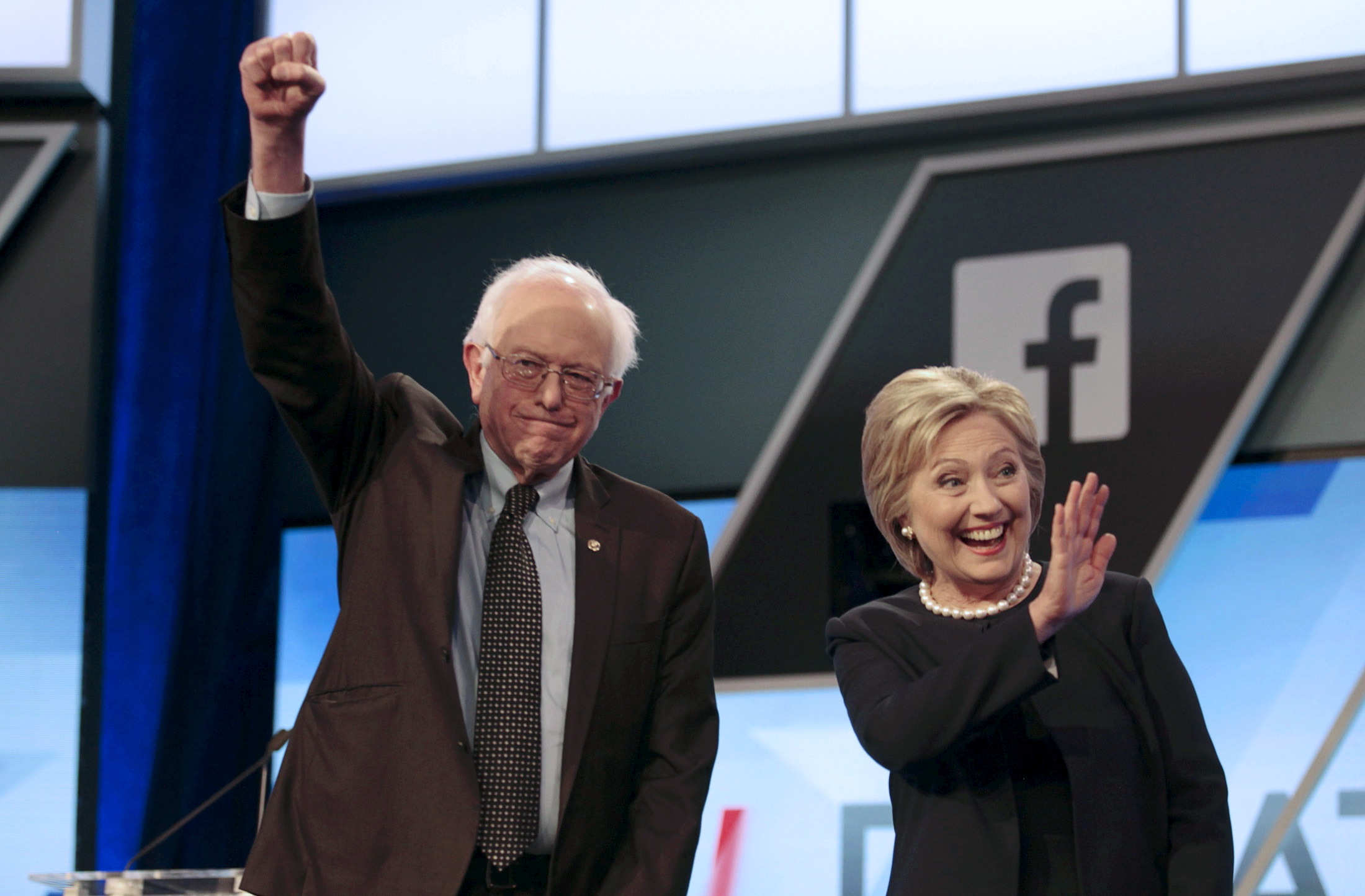 Democratic U.S. presidential candidates Senator Bernie Sanders and Hillary Clinton wave before the start of the Univision News and Washington Post Democratic U.S. presidential candidates debate in Kendall
