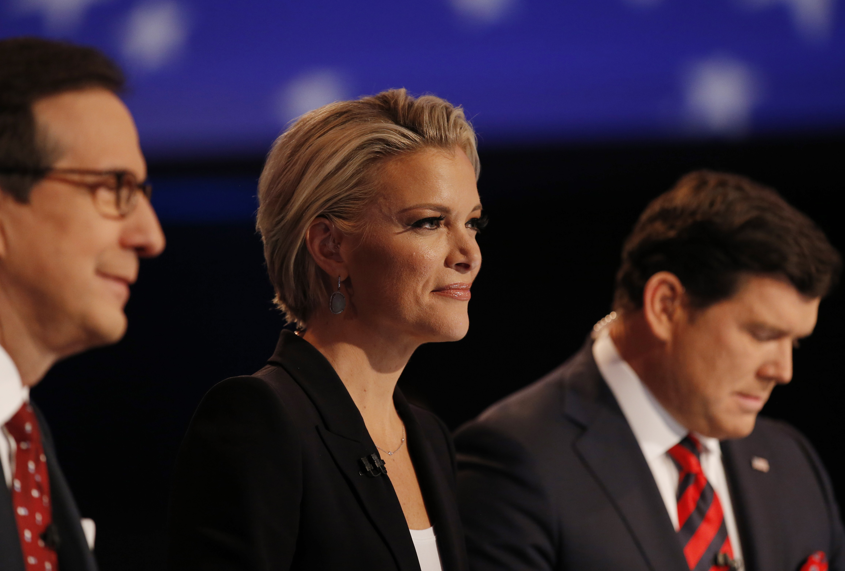 Fox News Channel anchor Kelly sits between fellow debate moderators Wallace and Baier during the debate held by Fox News for the top 2016 U.S. Republican presidential candidates in Des Moines