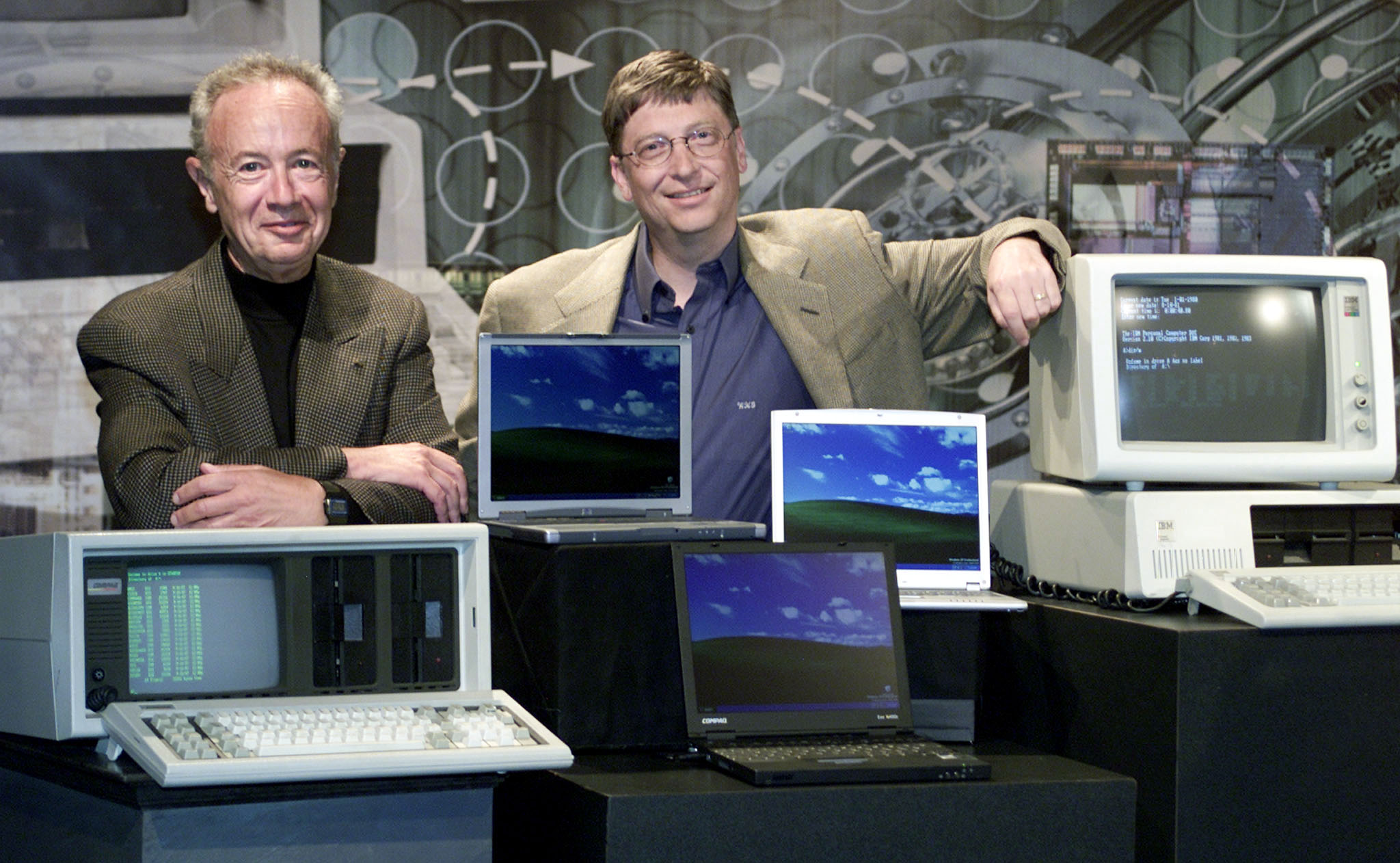 Bill Gates (R), chairman and chief software architect of Microsoft, poses for photographers with And..