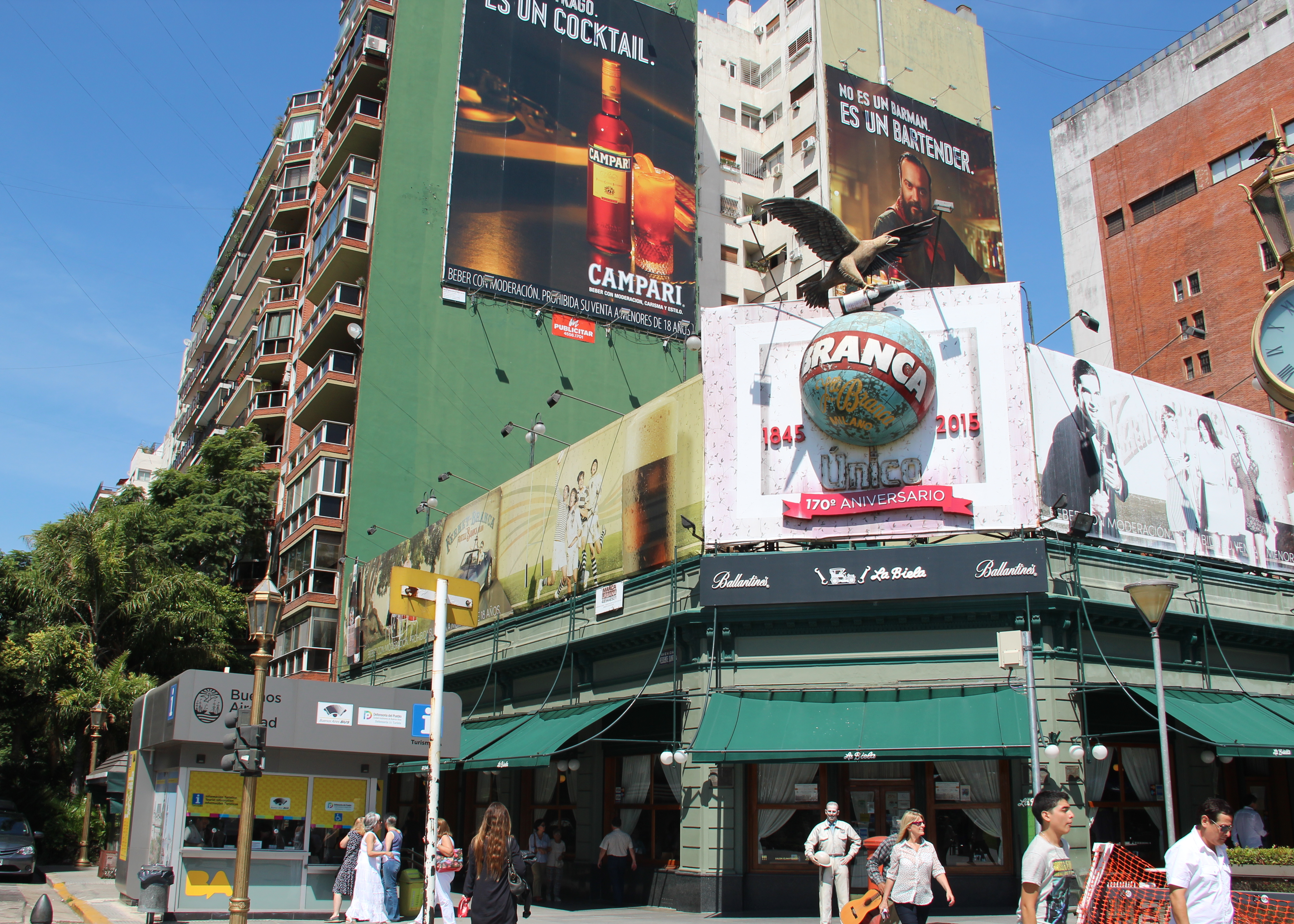 The Fernet Branca logo above a cafe in Buenos Aires with an advertisement for Campari, a new rival, behind.