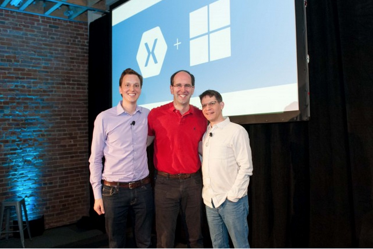 Microsoft Scott Guthrie flanked by Xamarin's Nat Friedman (l.) and Miguel de Icaza.