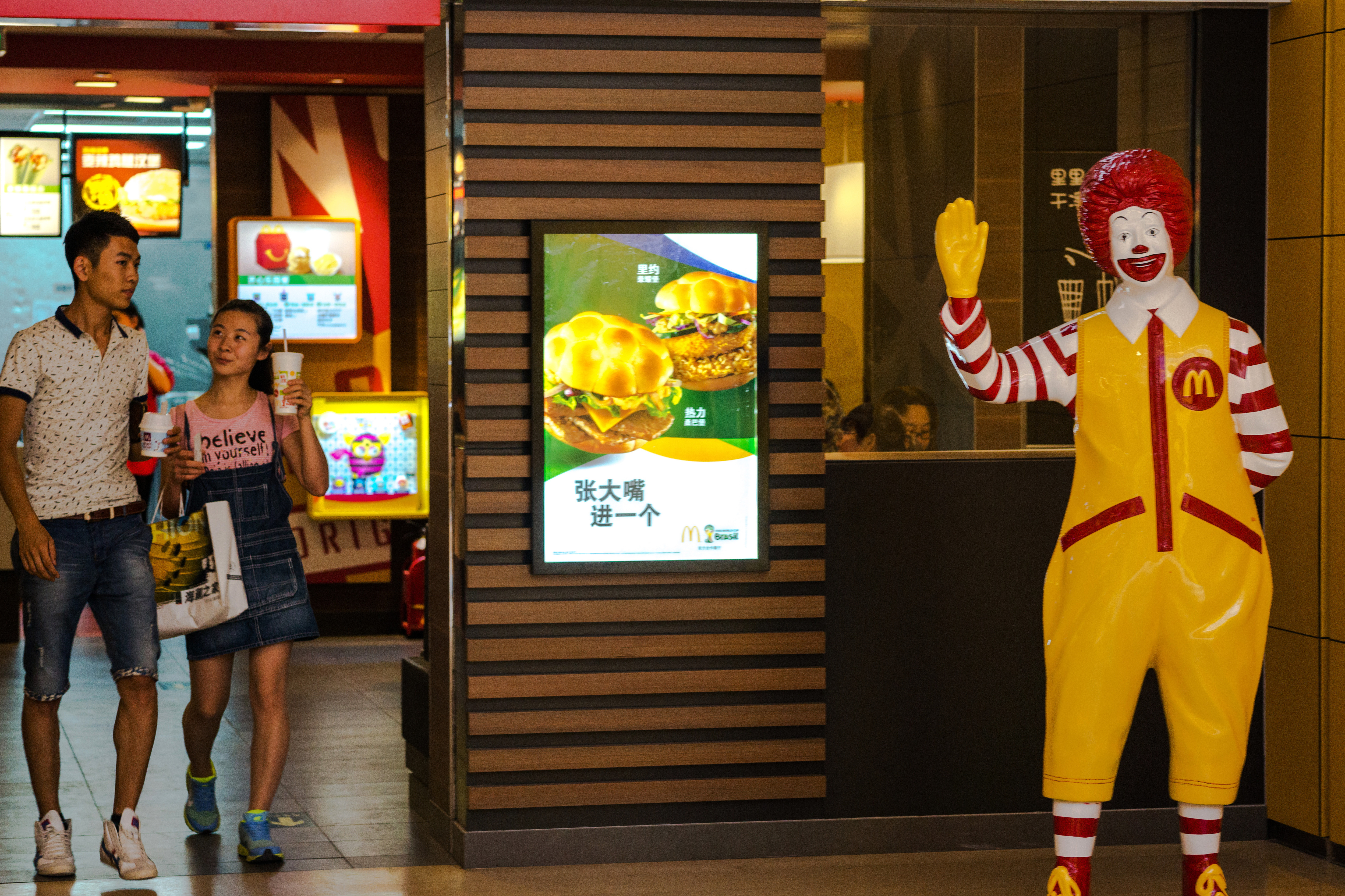 Customers and Ronald McDonald in a McDonalds restaurant