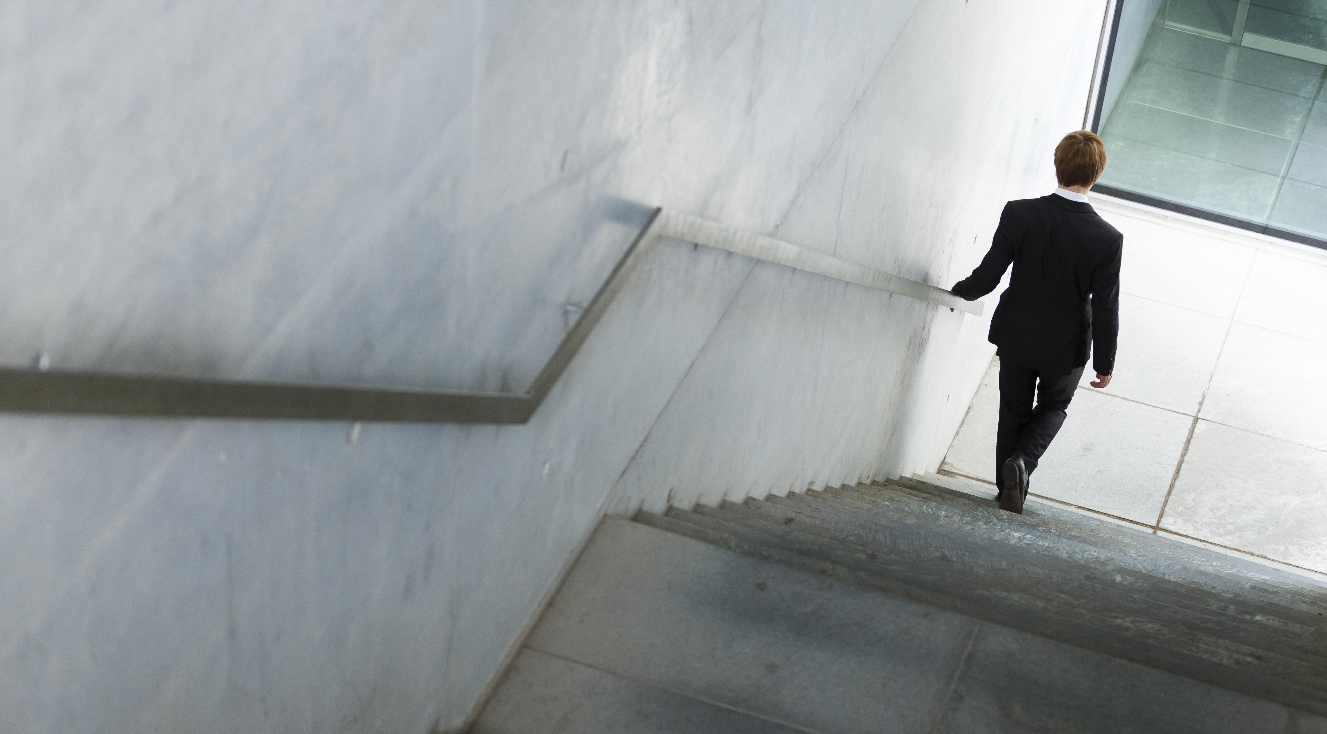 Man walks downstairs