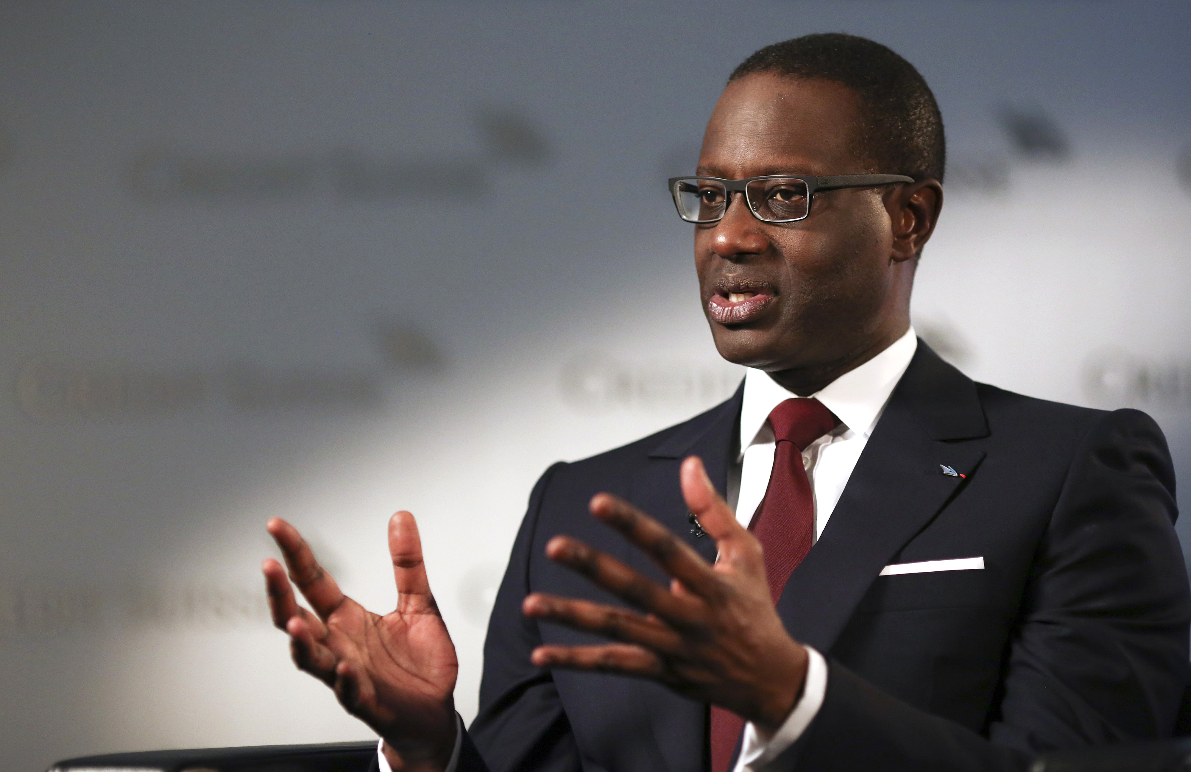 Tidjane Thiam, chief executive officer for Credit Suisse Group AG, speaks during a Bloomberg Television interview at the banks headquarters in Zurich, Switzerland, on Thursday, July 23, 2015. The bank posted a profit of 1.05 billion francs ($1.1 billion), beating many analysts' predictions. Photographer: Simon Dawson/Bloomberg *** Local Caption *** Tidjane Thiam